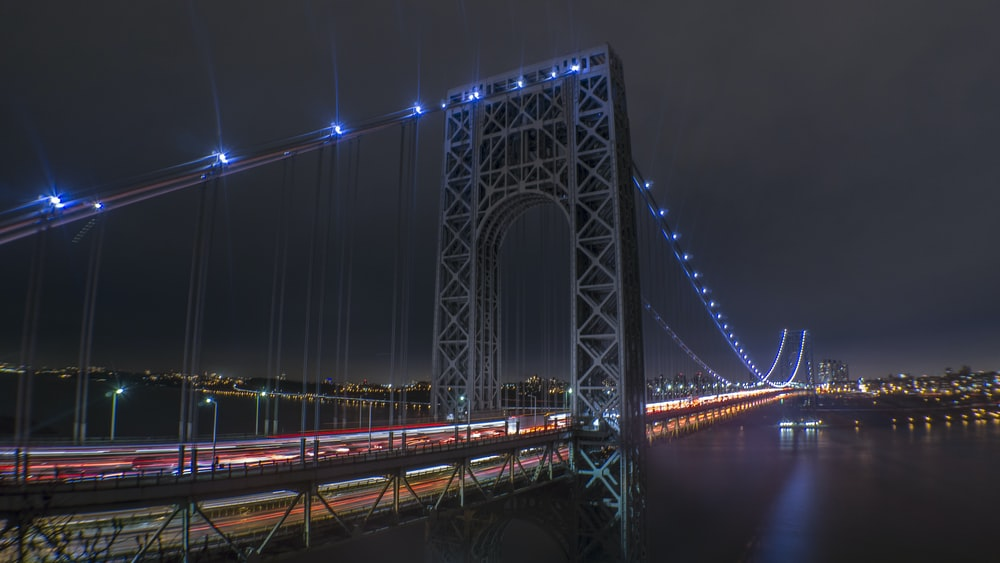 lighted suspension bridge wallpaper