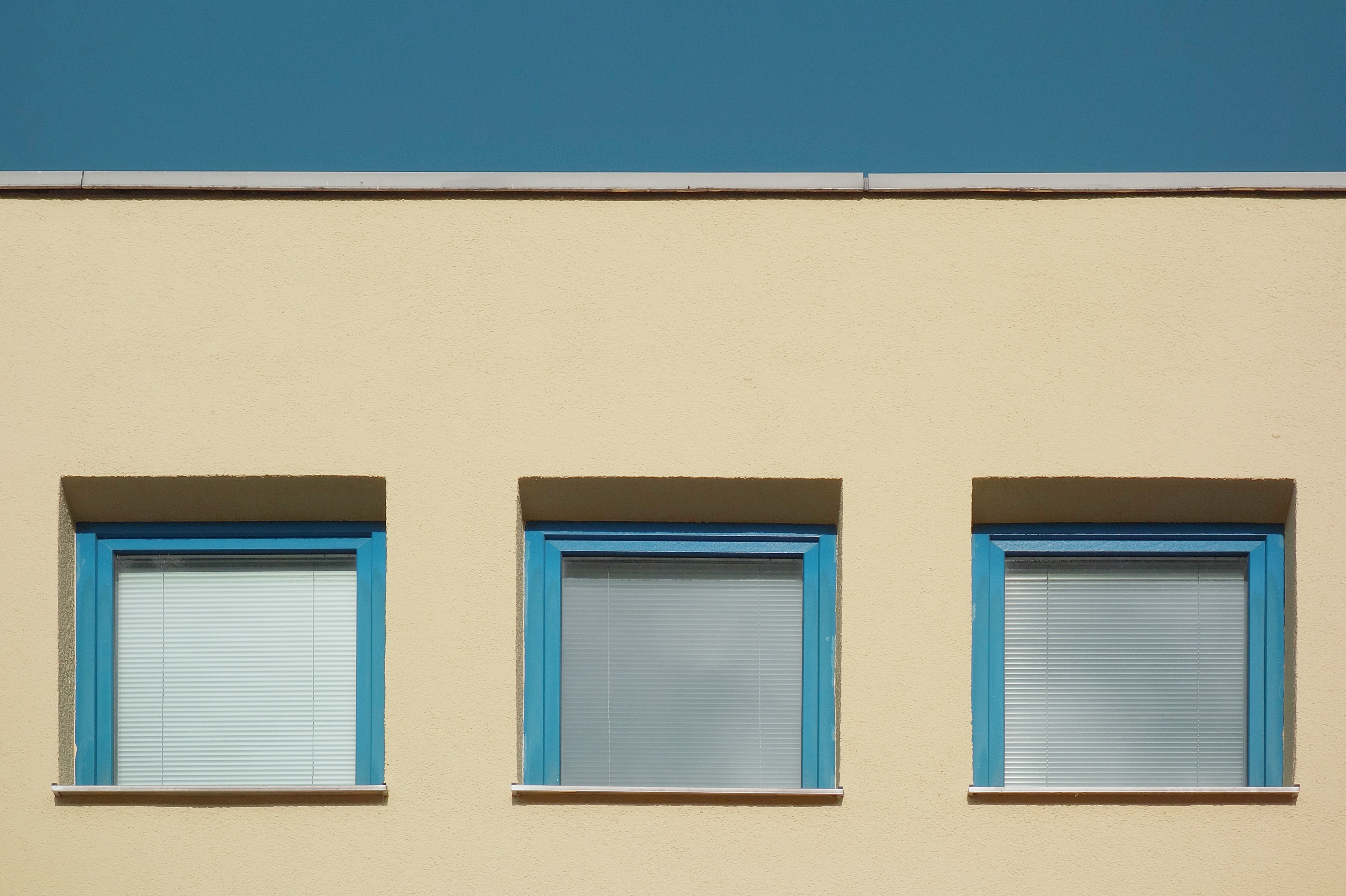 photo of three teal framed windows