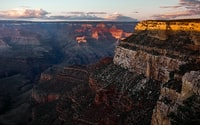 brown grand canyon under cloudy sky