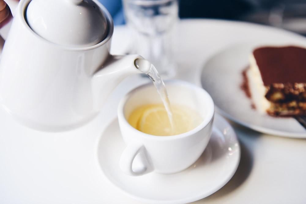 white ceramic teapot and teacup