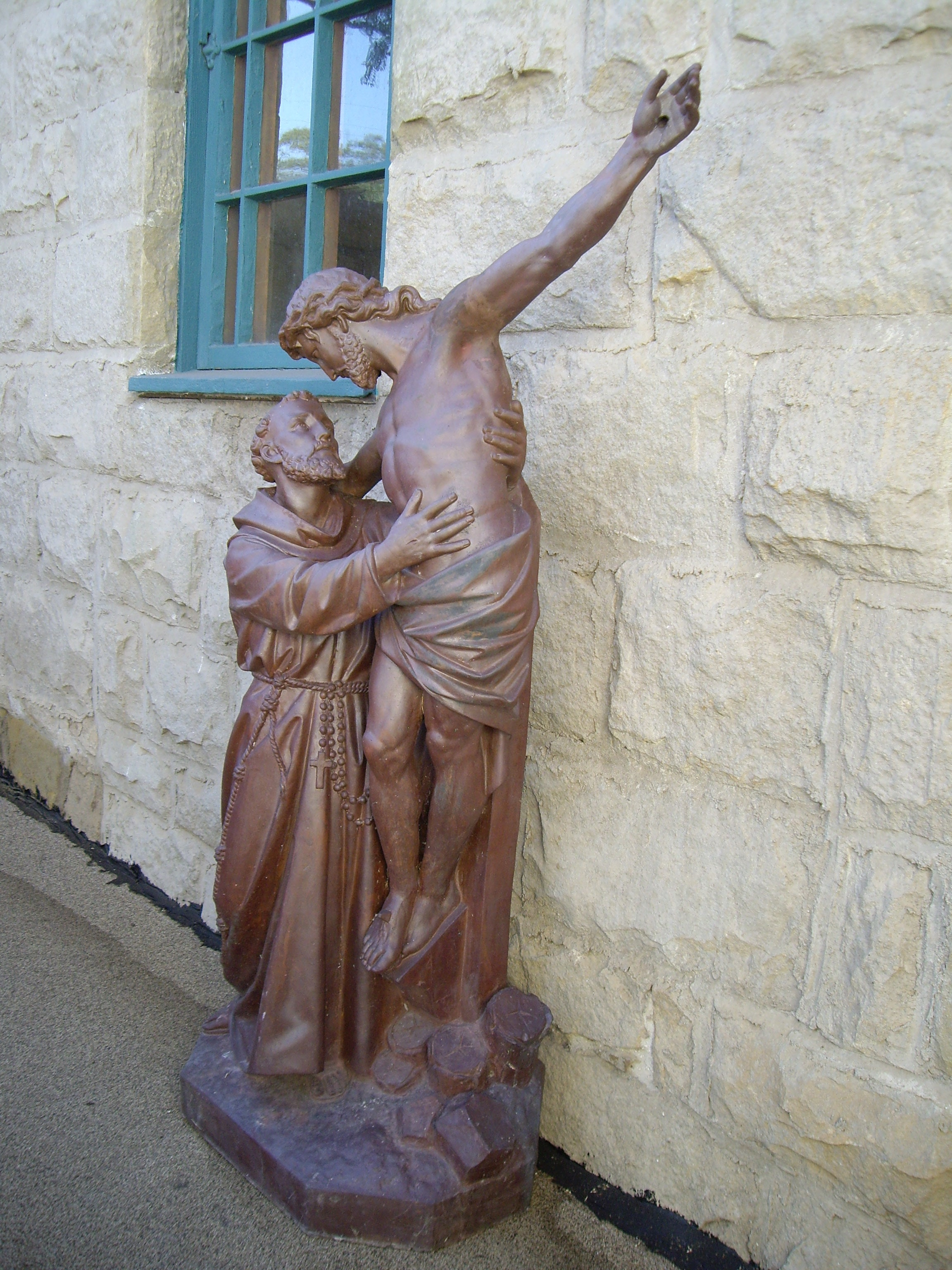 A statue outside of a church.