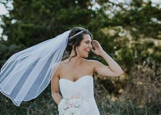 women's white wedding gown near grass