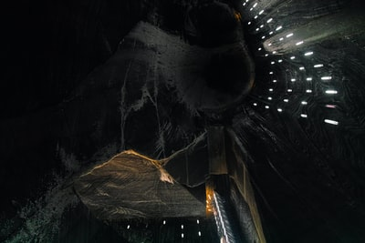 I took that image in a former romanian salt mine. It was one of the darkest, most surrealistic and impressing place I have ever been. You could even play minigolf and table tennis down there. The photo shows the 120 meter high vertical main tunnel.