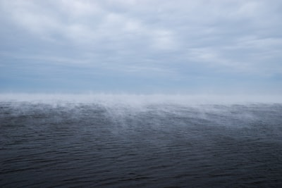 blue ocean water during daytime latvia teams background