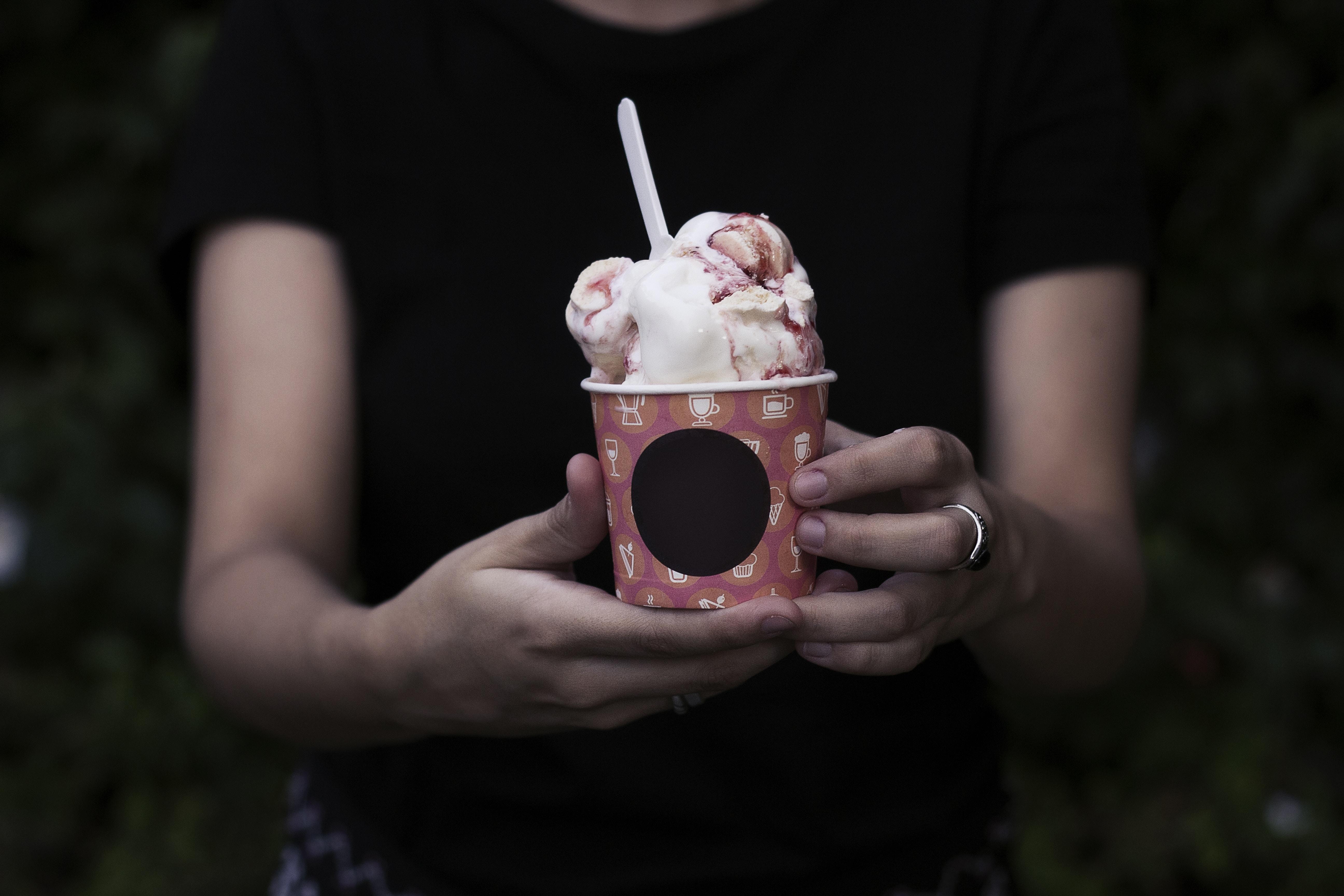 person holding bucket of ice cream