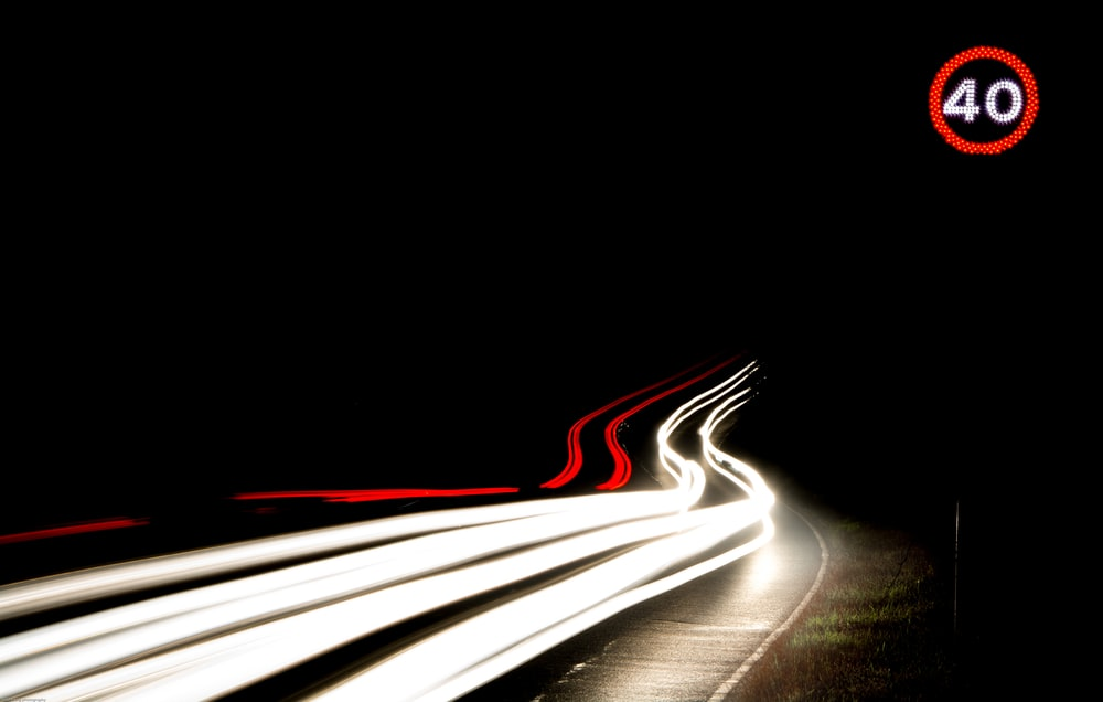 long-exposure photography of light streaks on road during nighttime