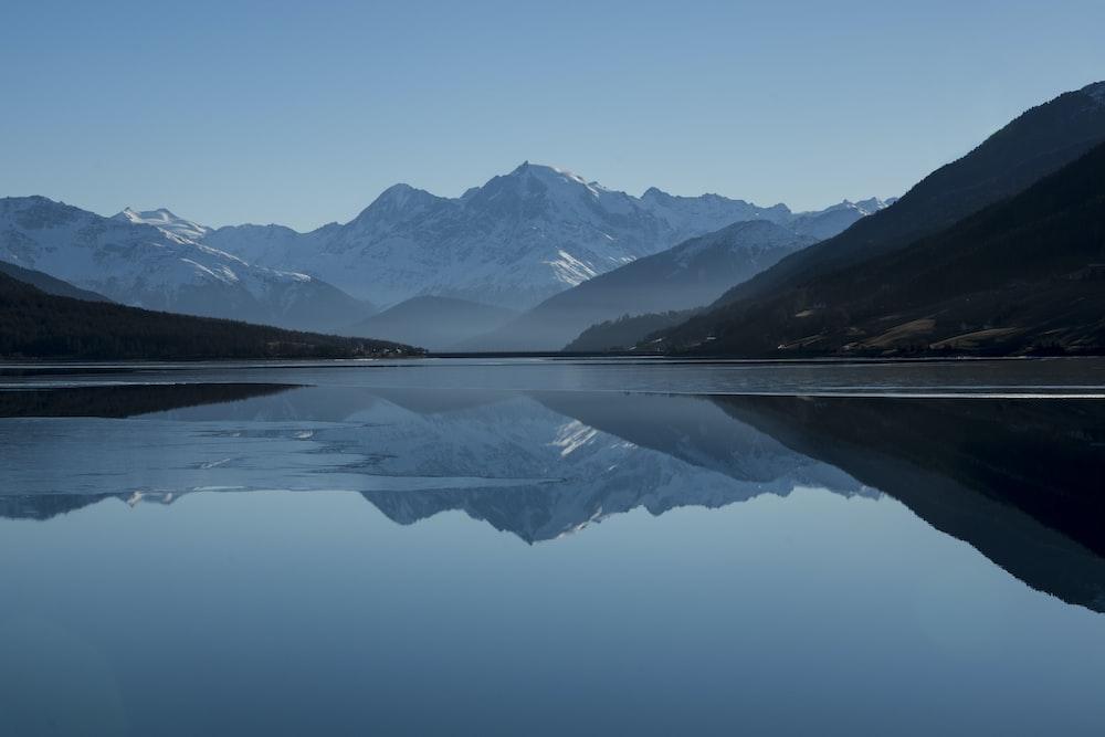 mountain near on body of water photo