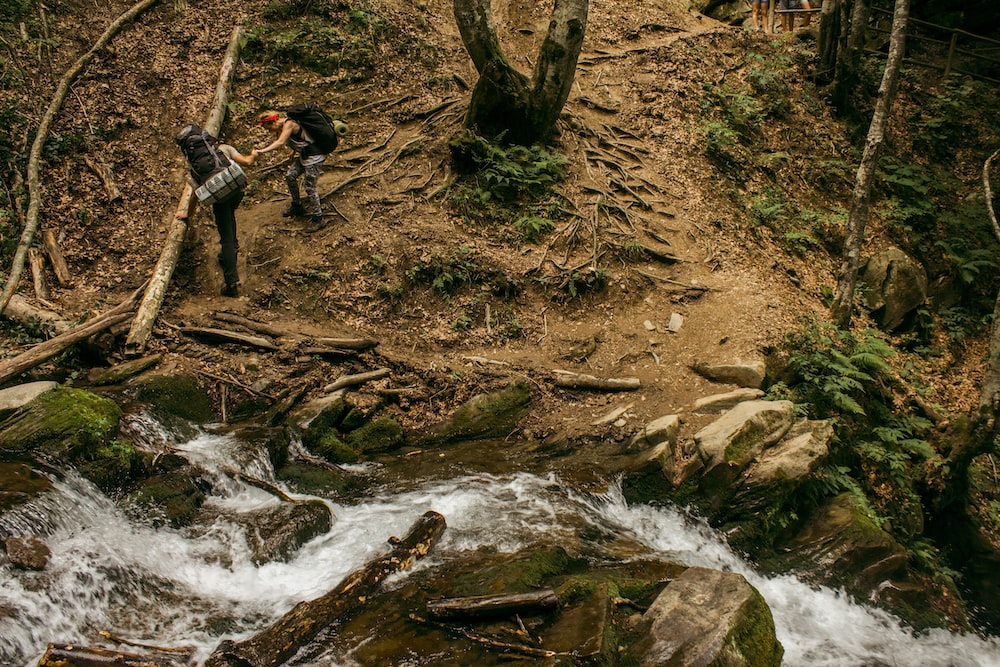 two person hiking in the mountain terrain