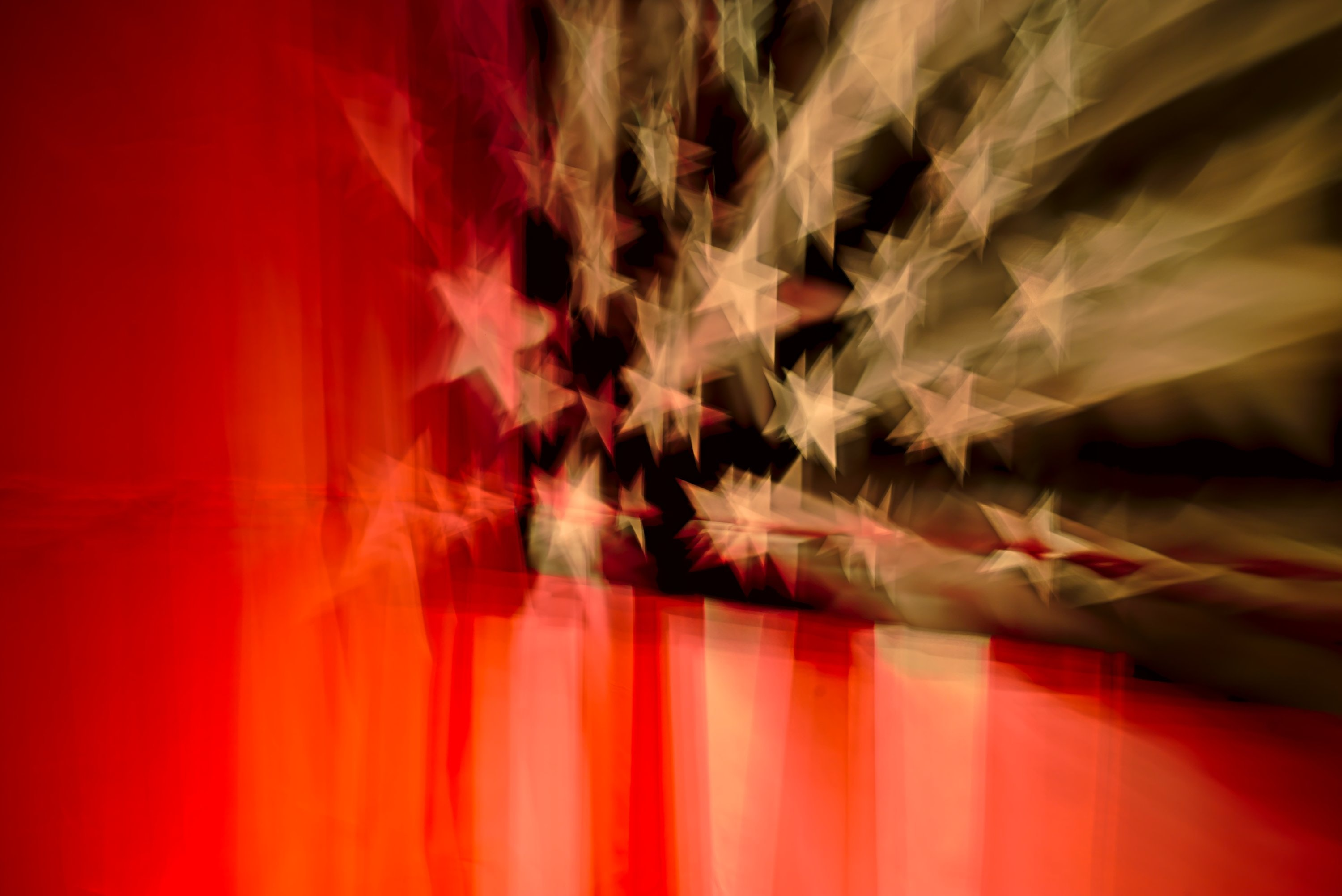 Blurry view of the stars and stripes on an American flag