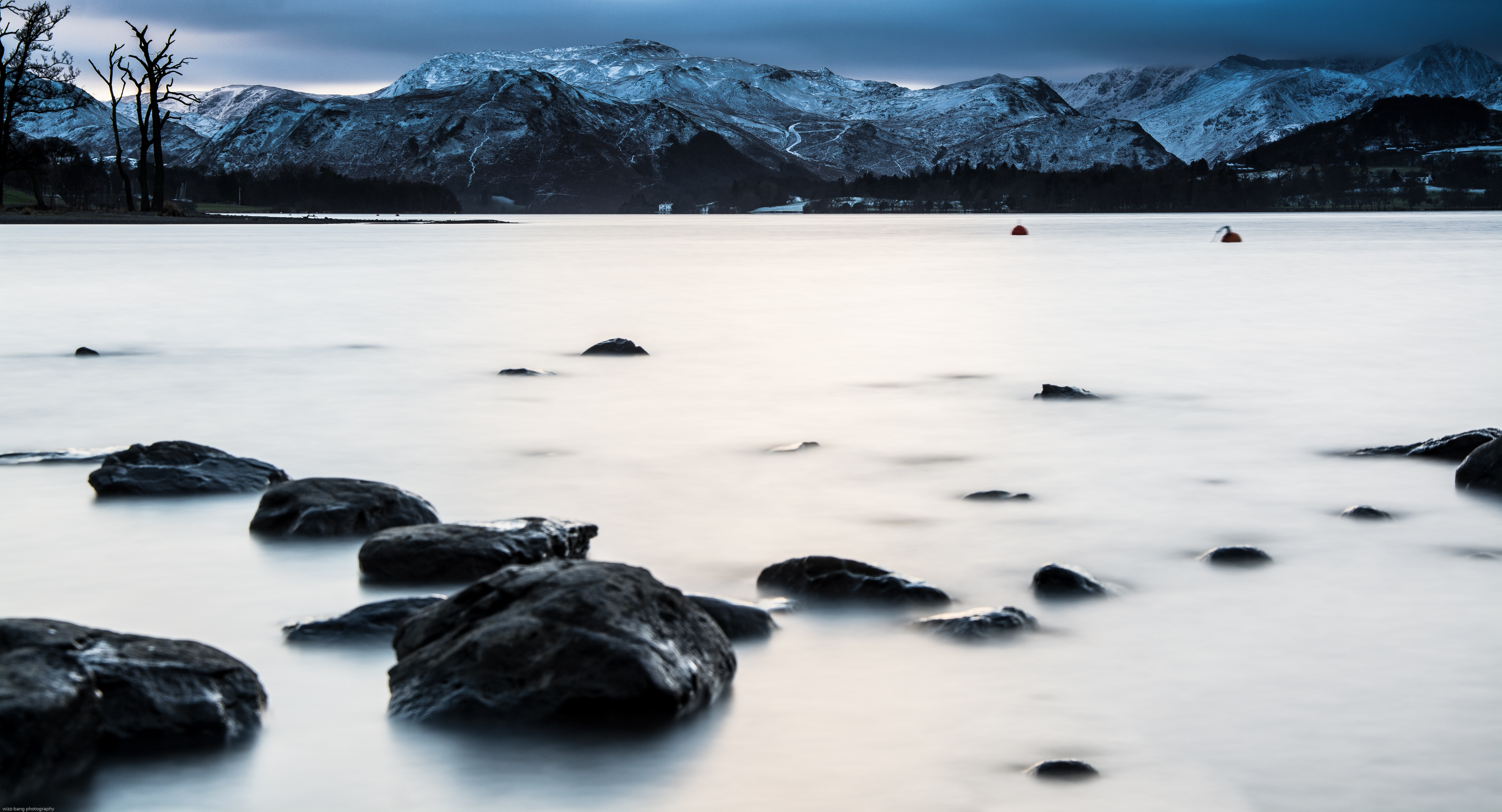 A landscape shot of a lake and mountain taken during the winter in Cumbria