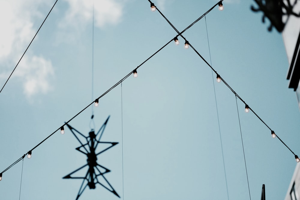 black hanging decor and string lights