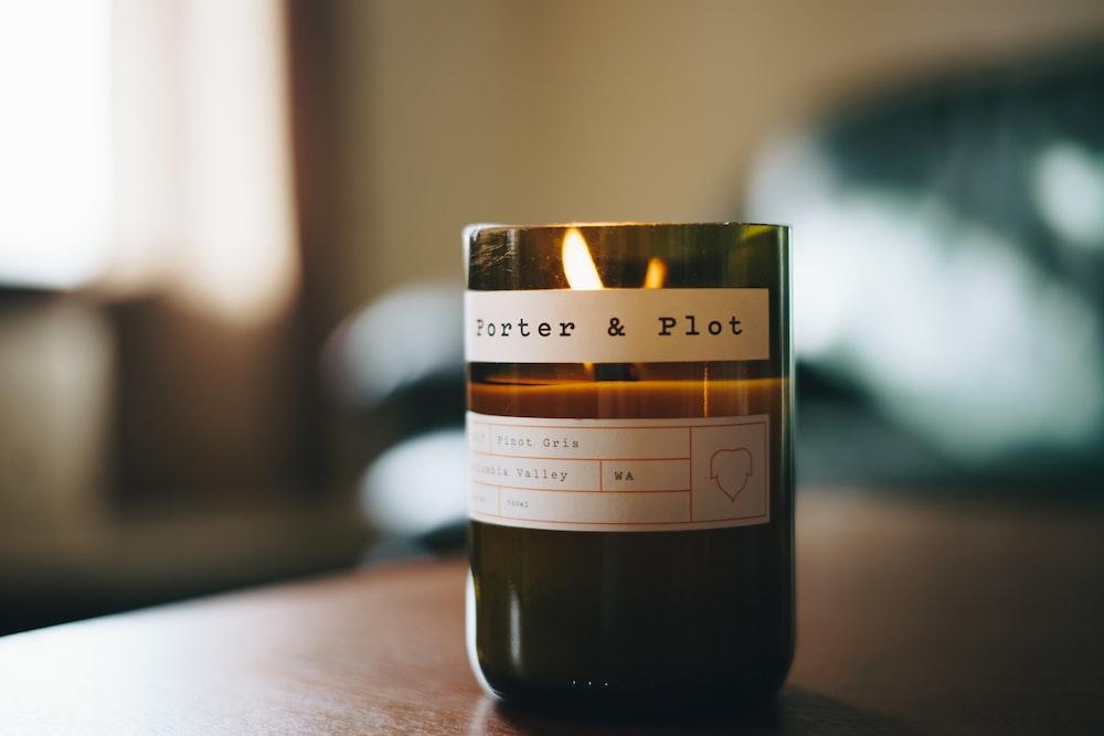 black votive candle shallow focus photography