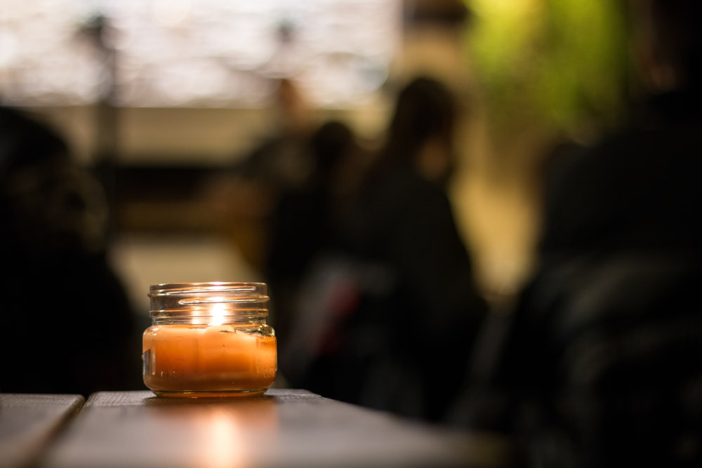 selective focus photo of votive candle