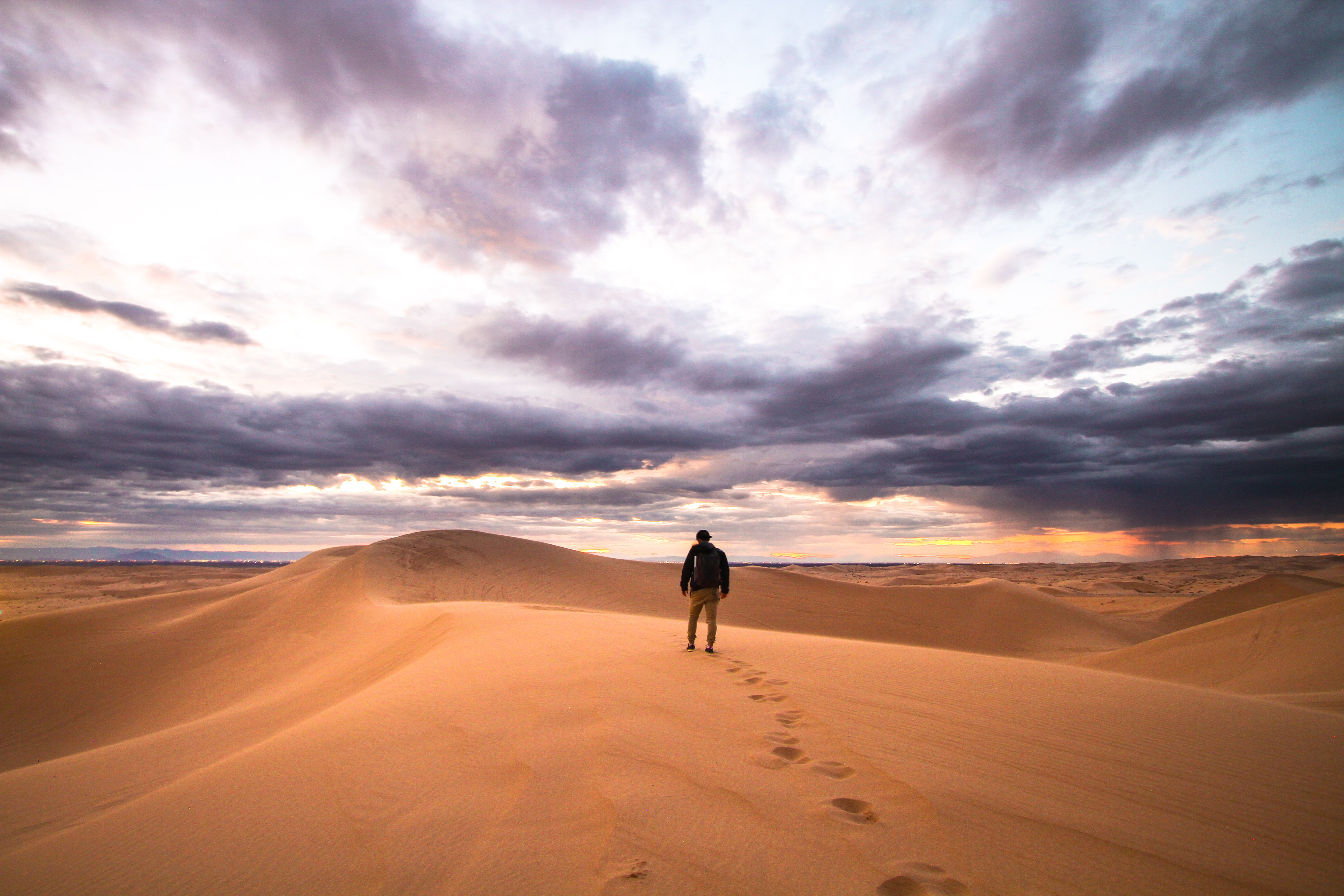 Person walks alone through the desert sands of Glamis