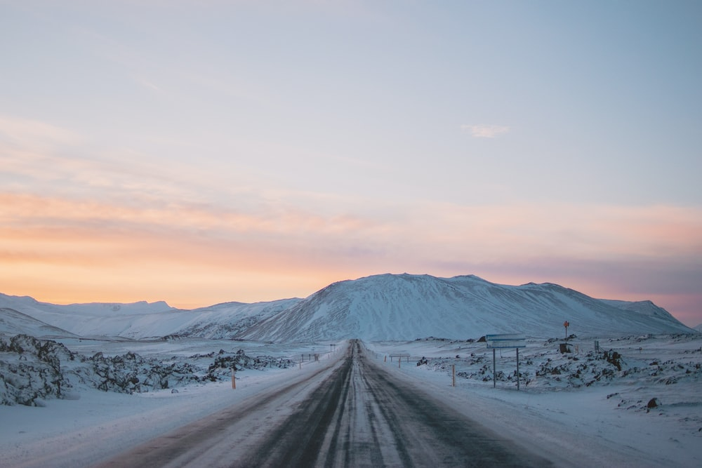 landscape photography of snow covered road and mountain