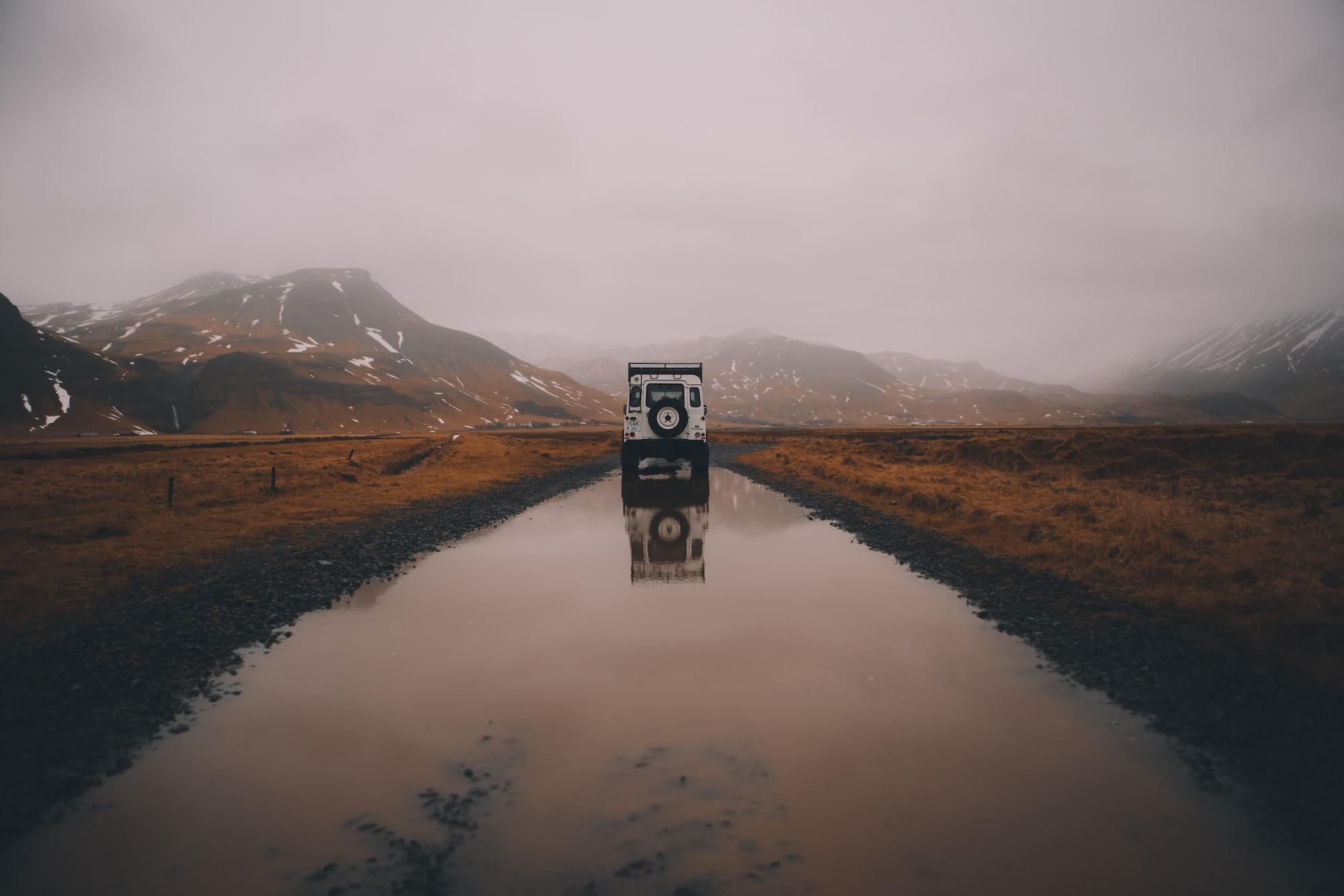 Land Rover in a foggy Skógar region