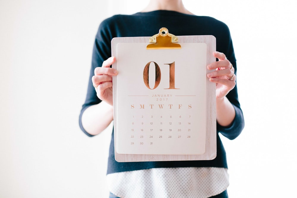 person holding calendar at January