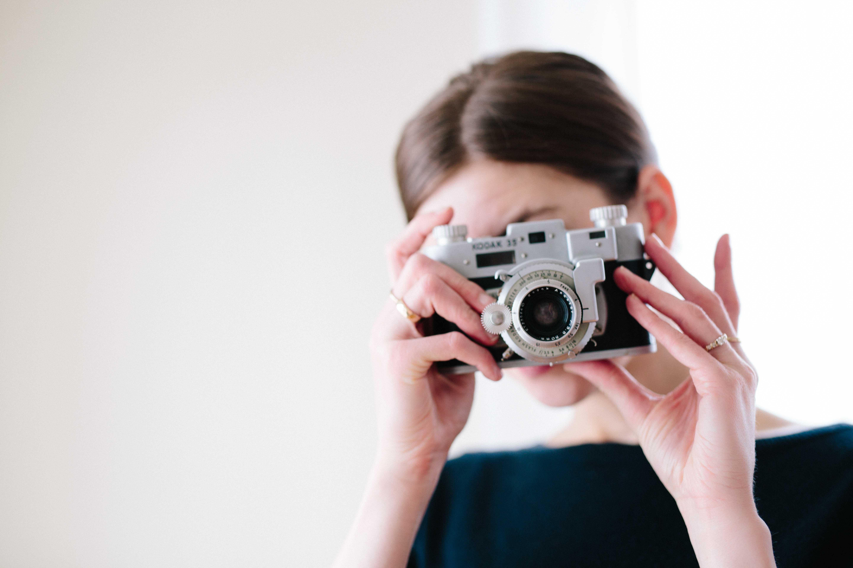 woman using camera taking photo
