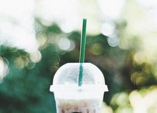 Starbucks smoothie on gray bench bokeh photography