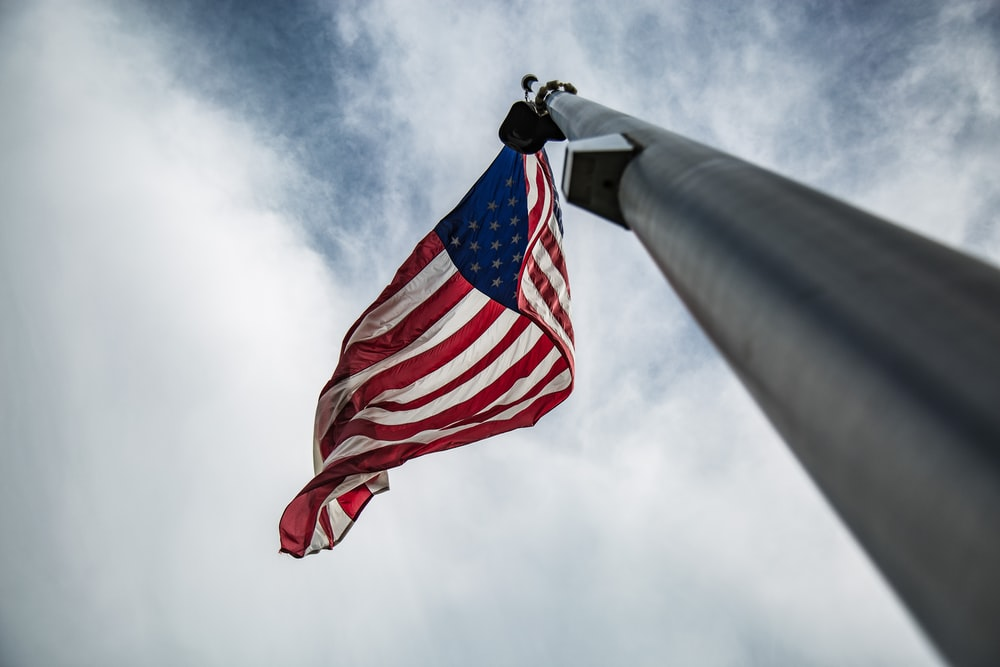 low-angled photography of U.S.A. flag on pole
