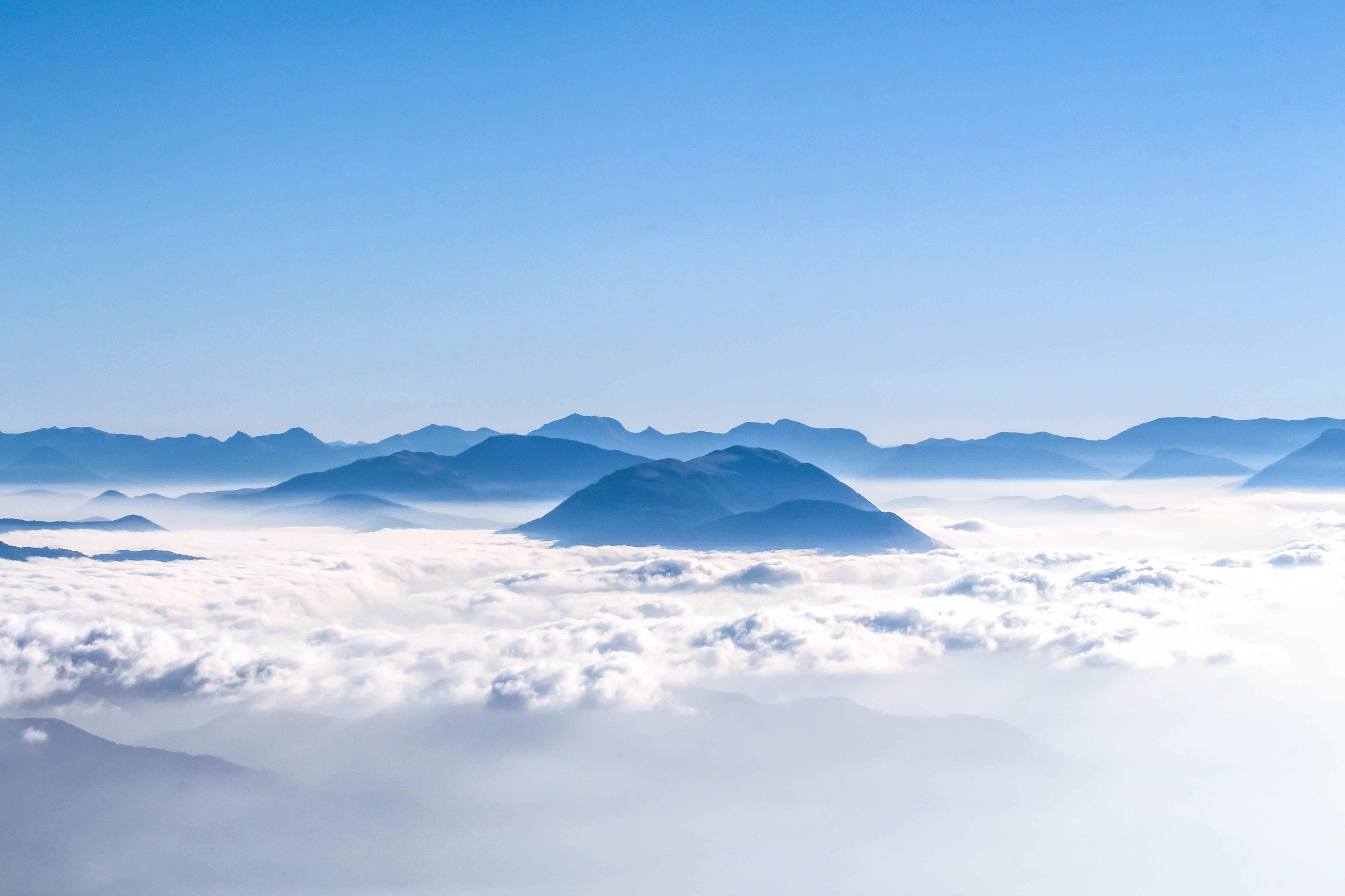The crest of the Dent de Crolles mountain jutting out from a sea of clouds