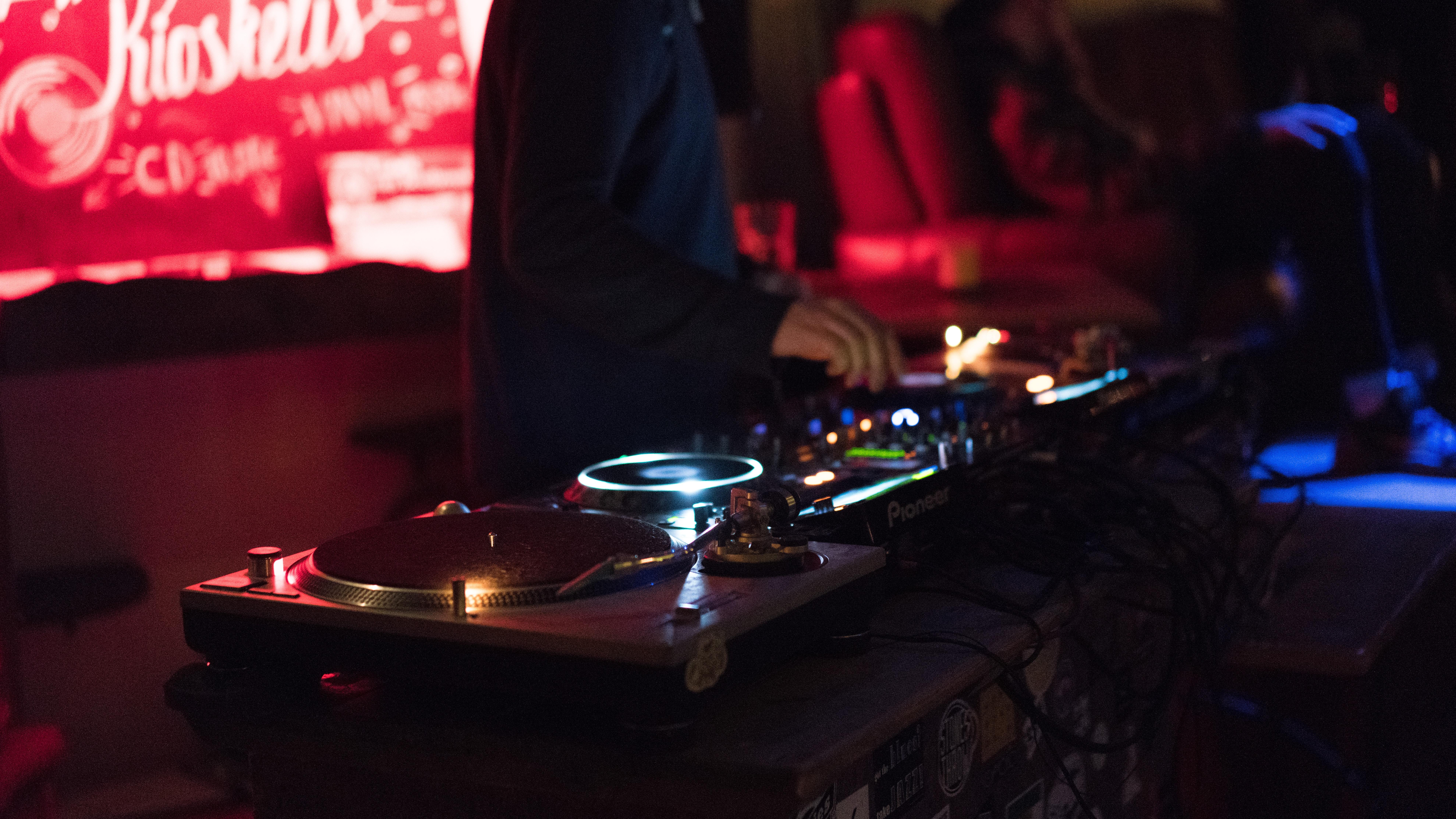 A DJ working their turntable at a club in Klaipėda