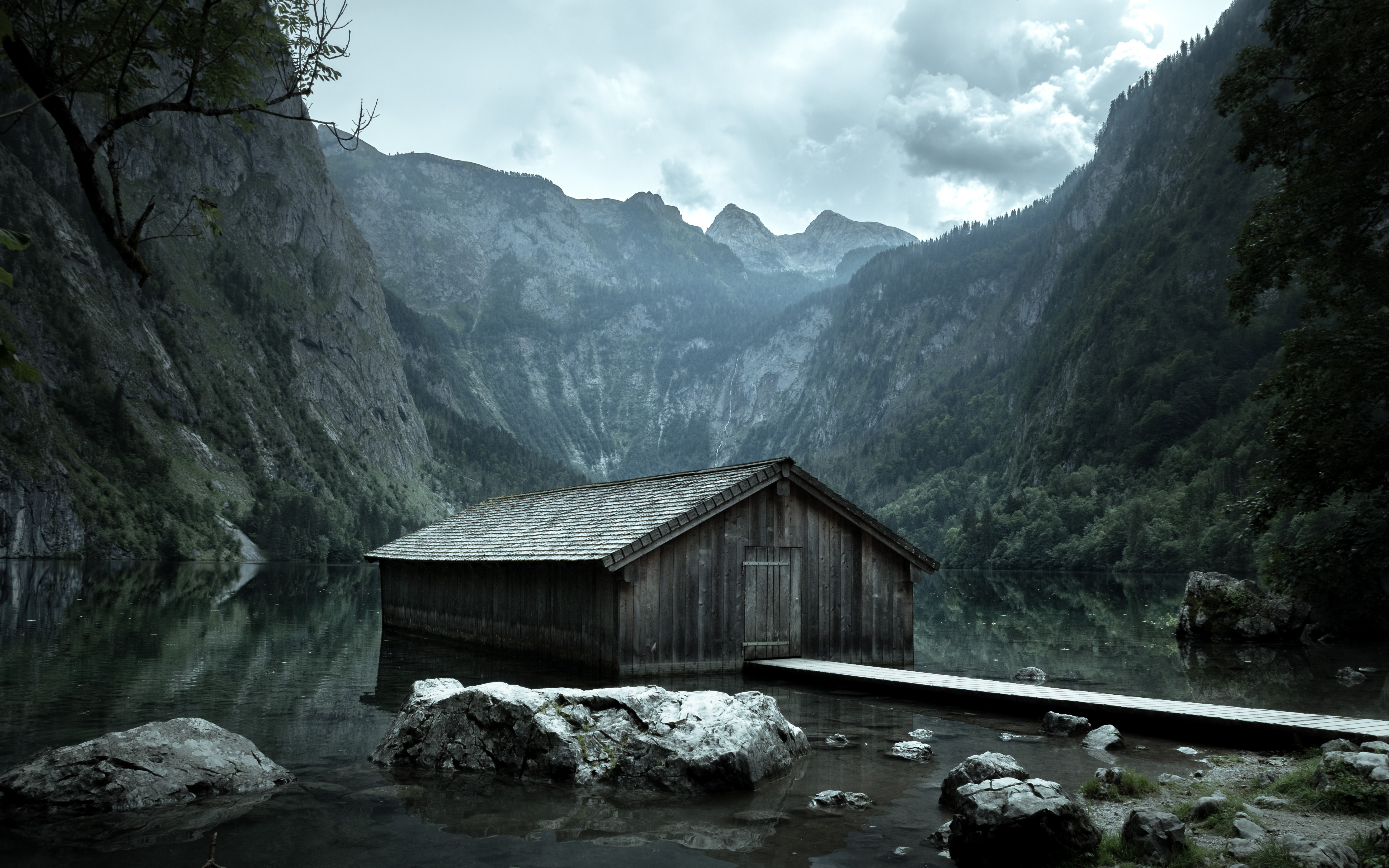 brown wooden cabin on body of water