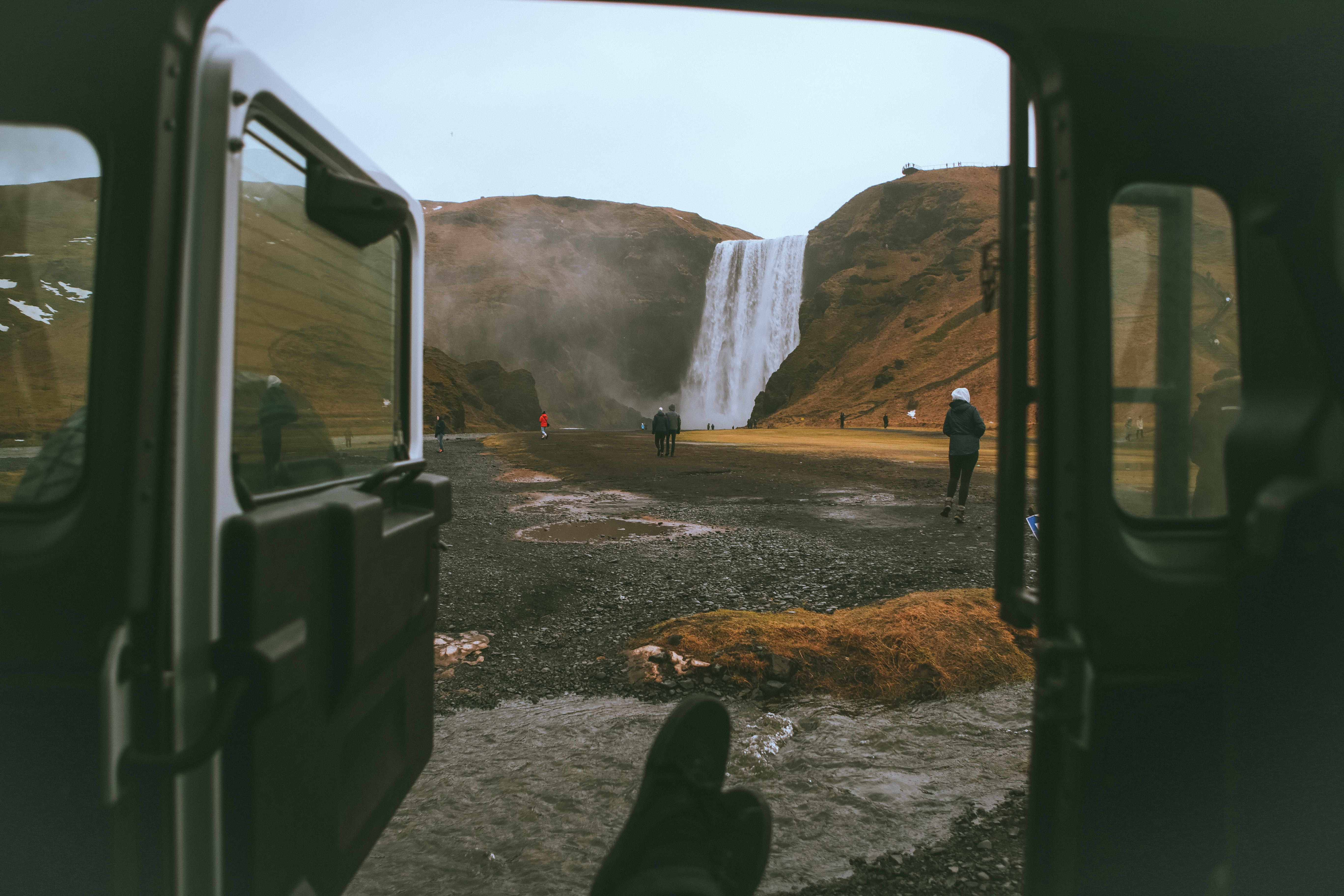 View of a waterfall from an open car door.