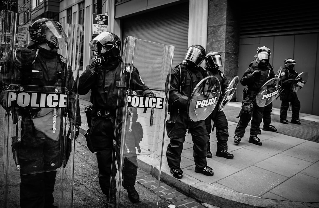 Two police laughing in full riot gear during the presidential inauguration. One of the most poignant photos I took that day.