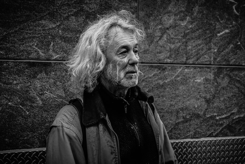 grayscale photo of long-haired man
