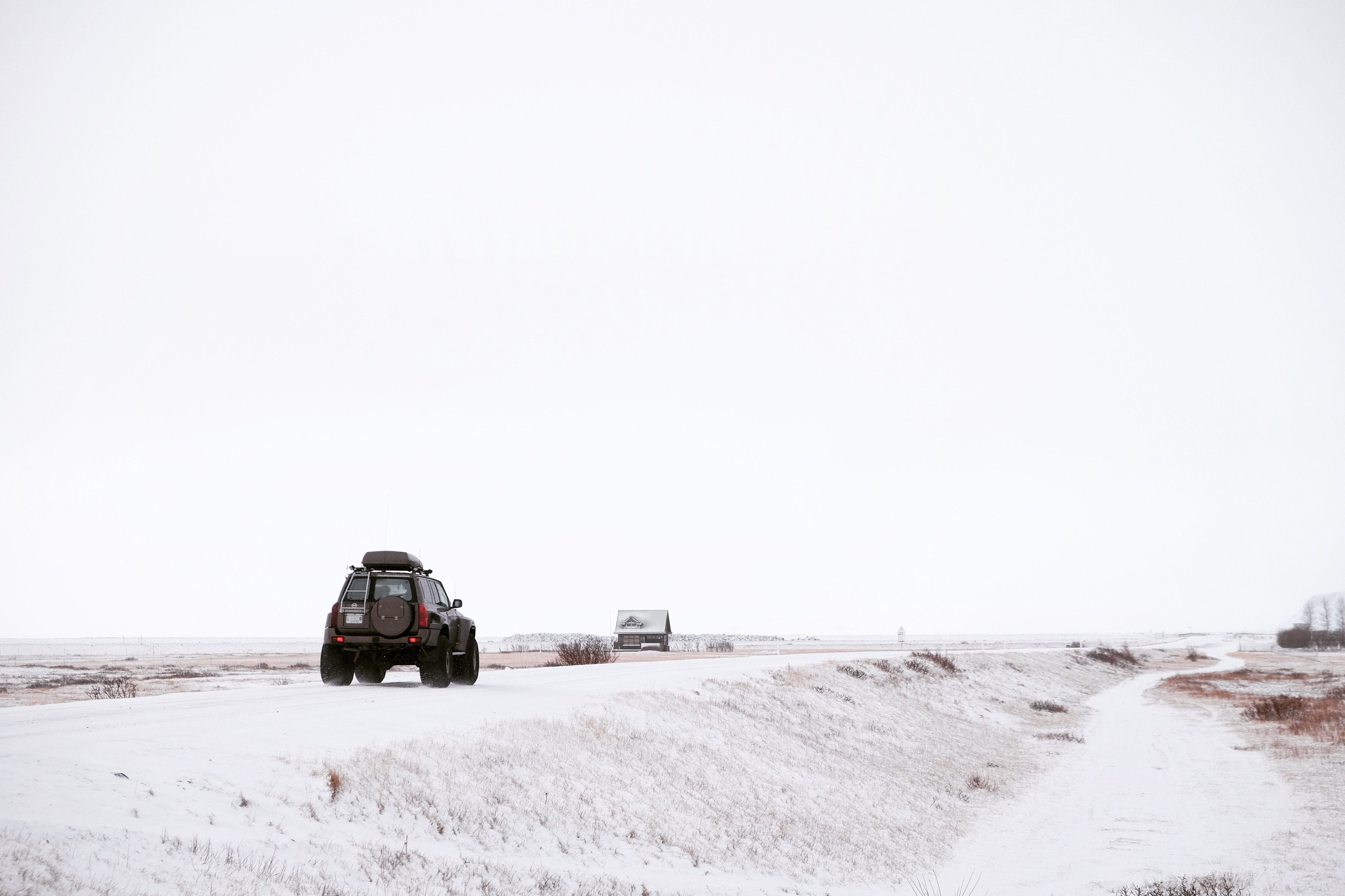 Offroad jeep driving on the rural snowy road during winter in Iceland