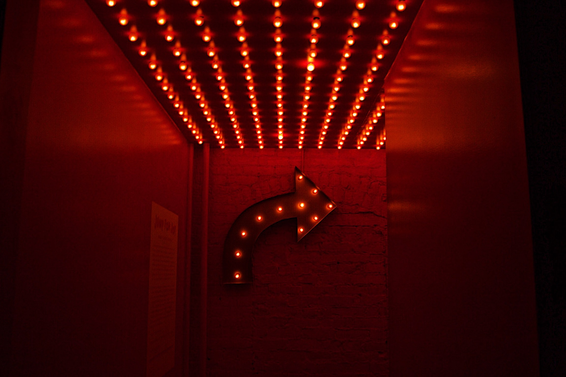 red marquee light going right