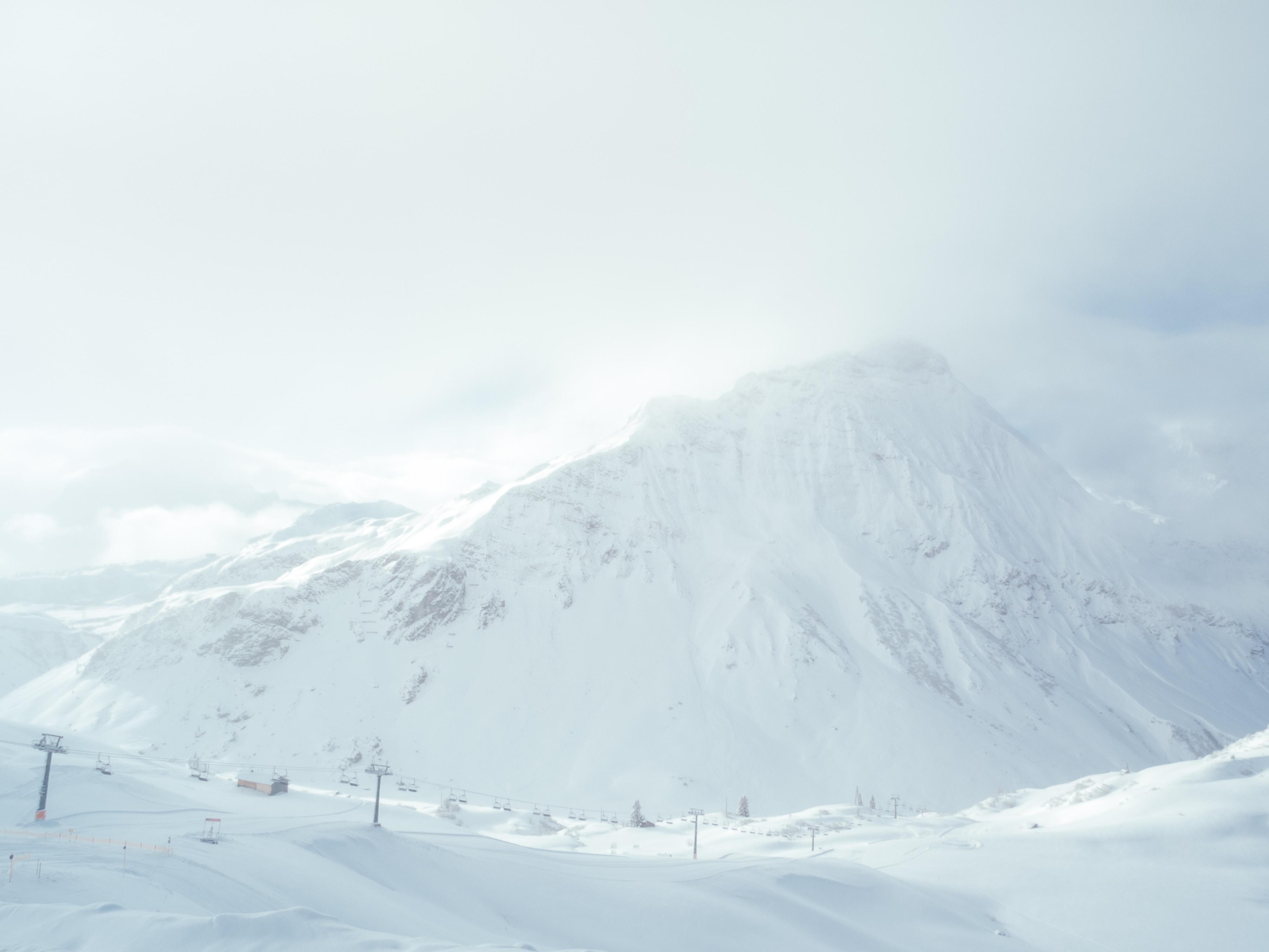 white mountain filled with snow under white sky