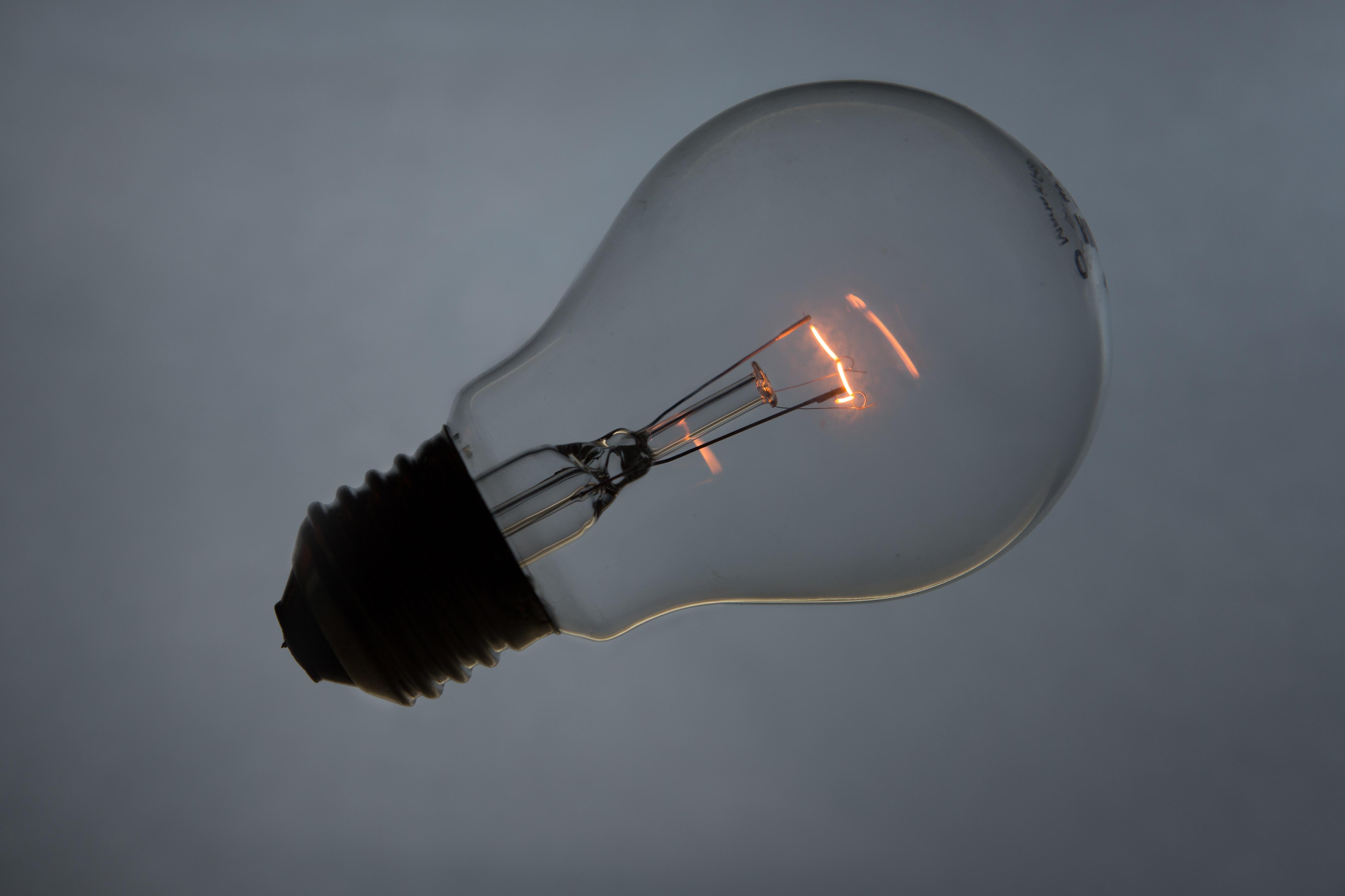 Wireless light bulb with glowing filament inside