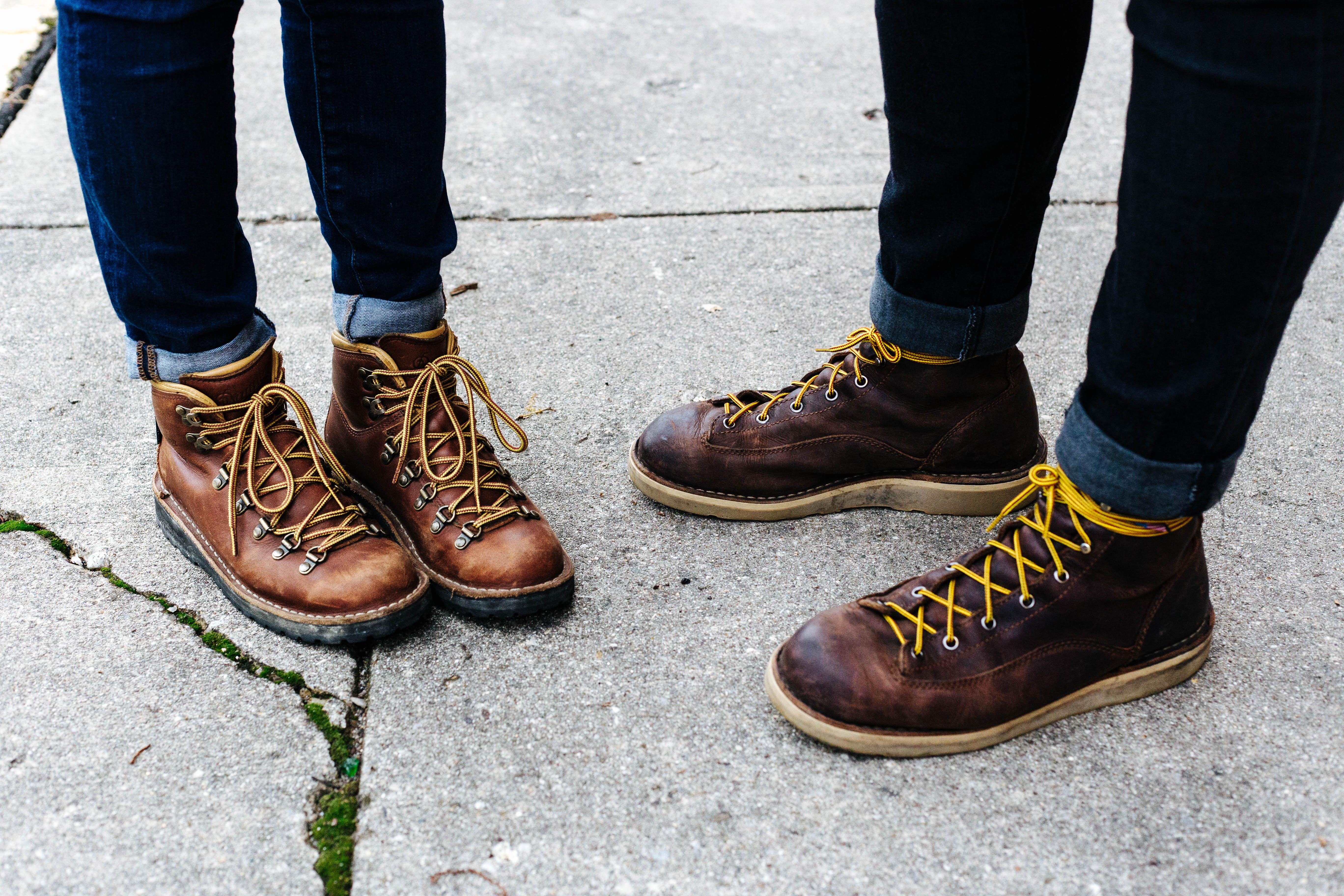 two person wearing brown leather boots