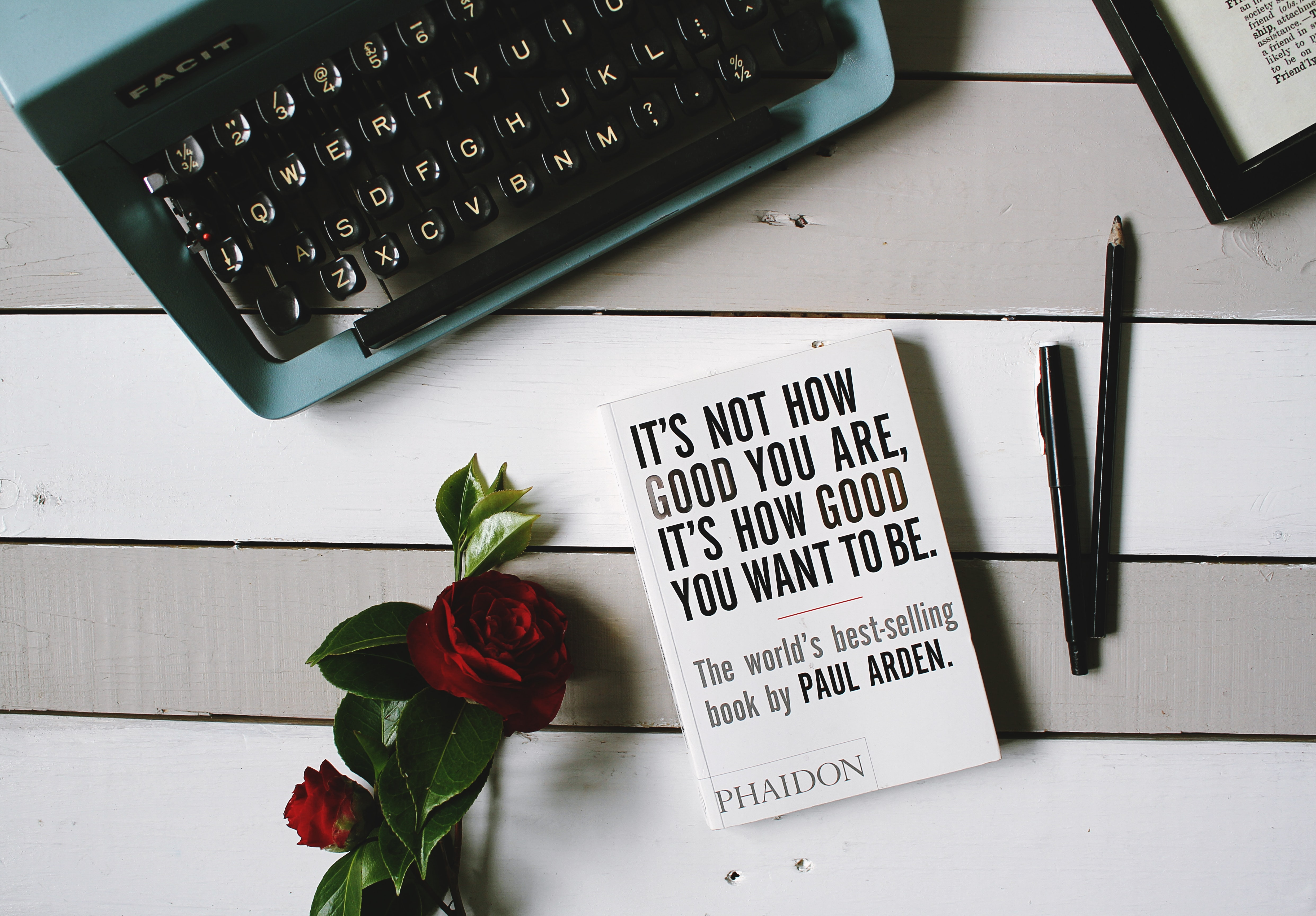 A flatlay image with a keyboard and a motivational message.