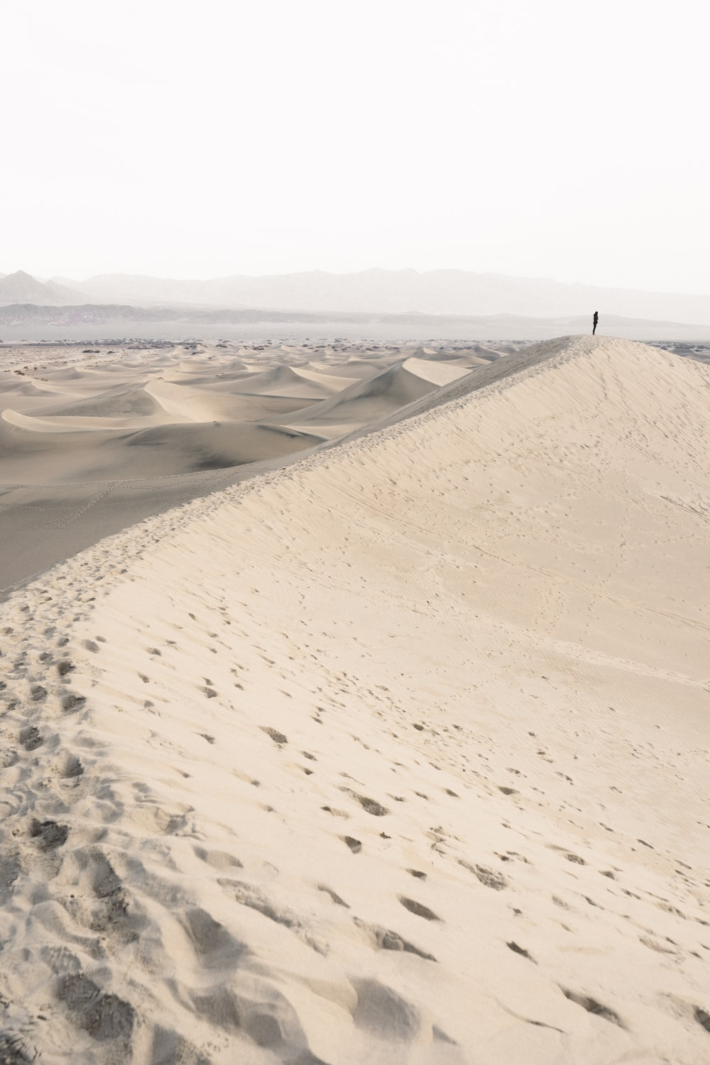 person standing on desert during daytime