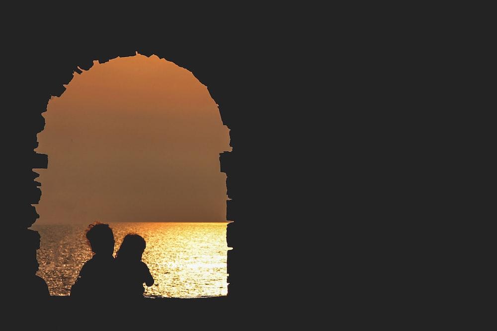 silhouette on building facing sea
