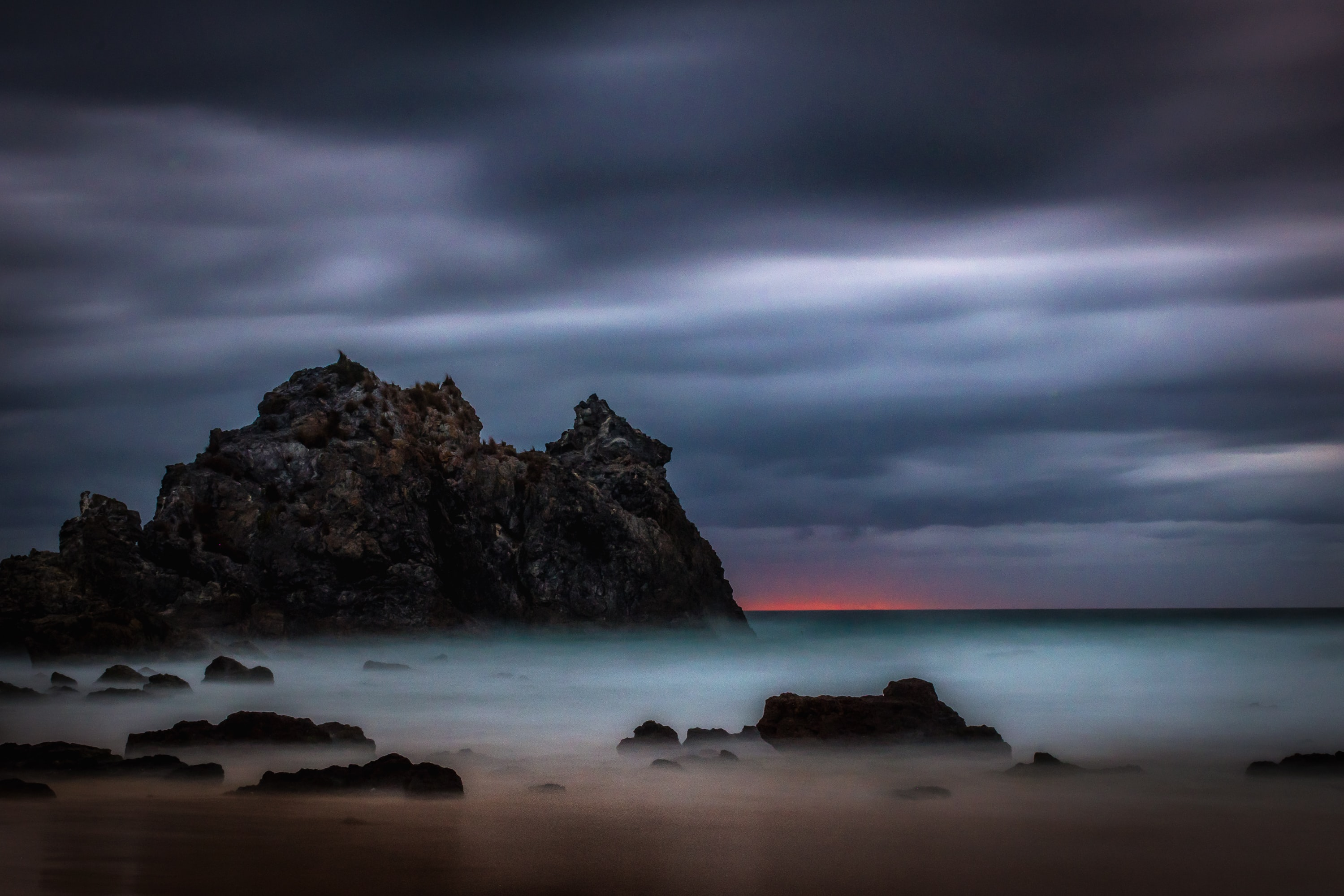 landscape photography of sea and rock formations