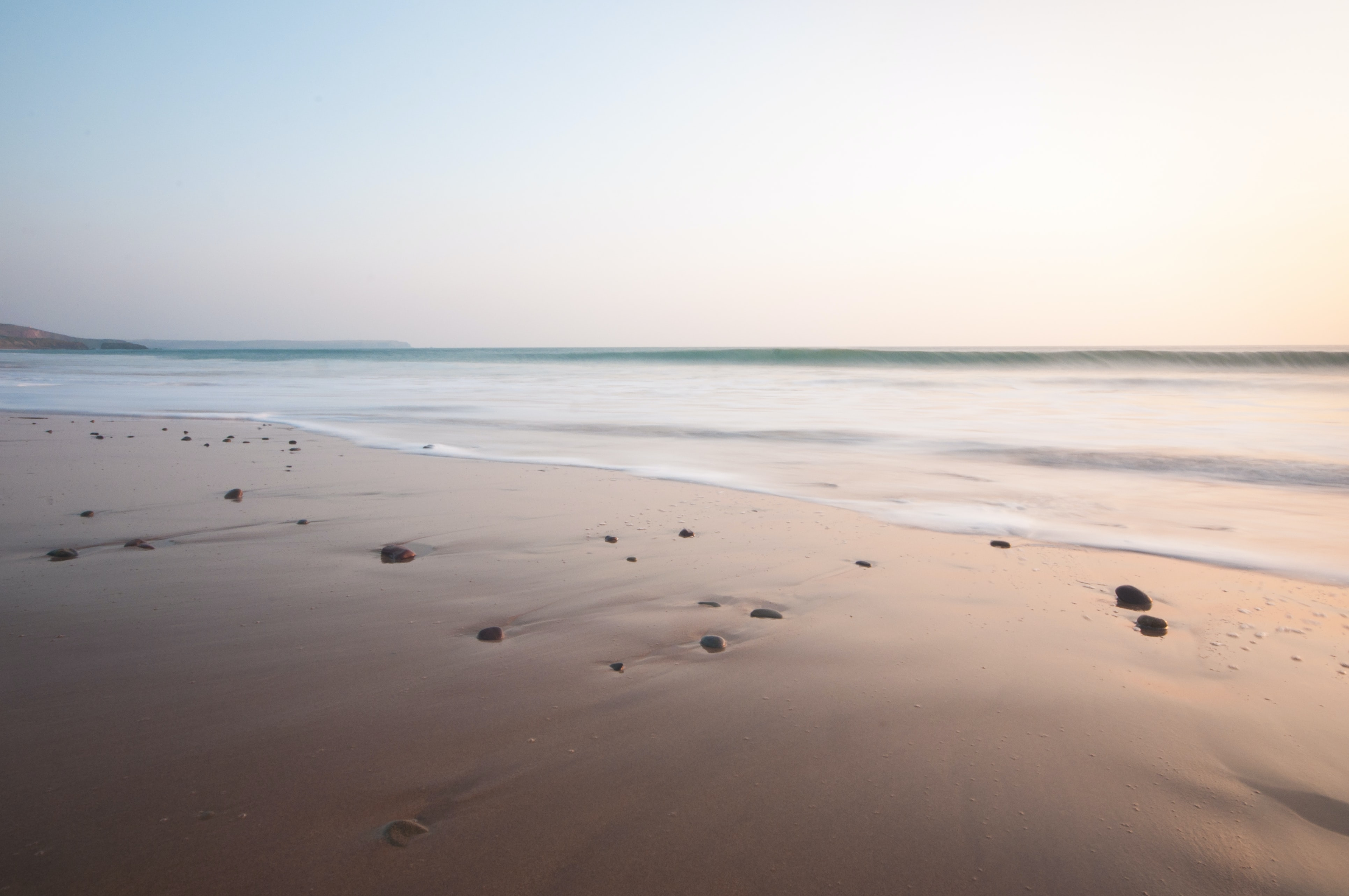 Ocean washing ashore Freshwater West sand beach