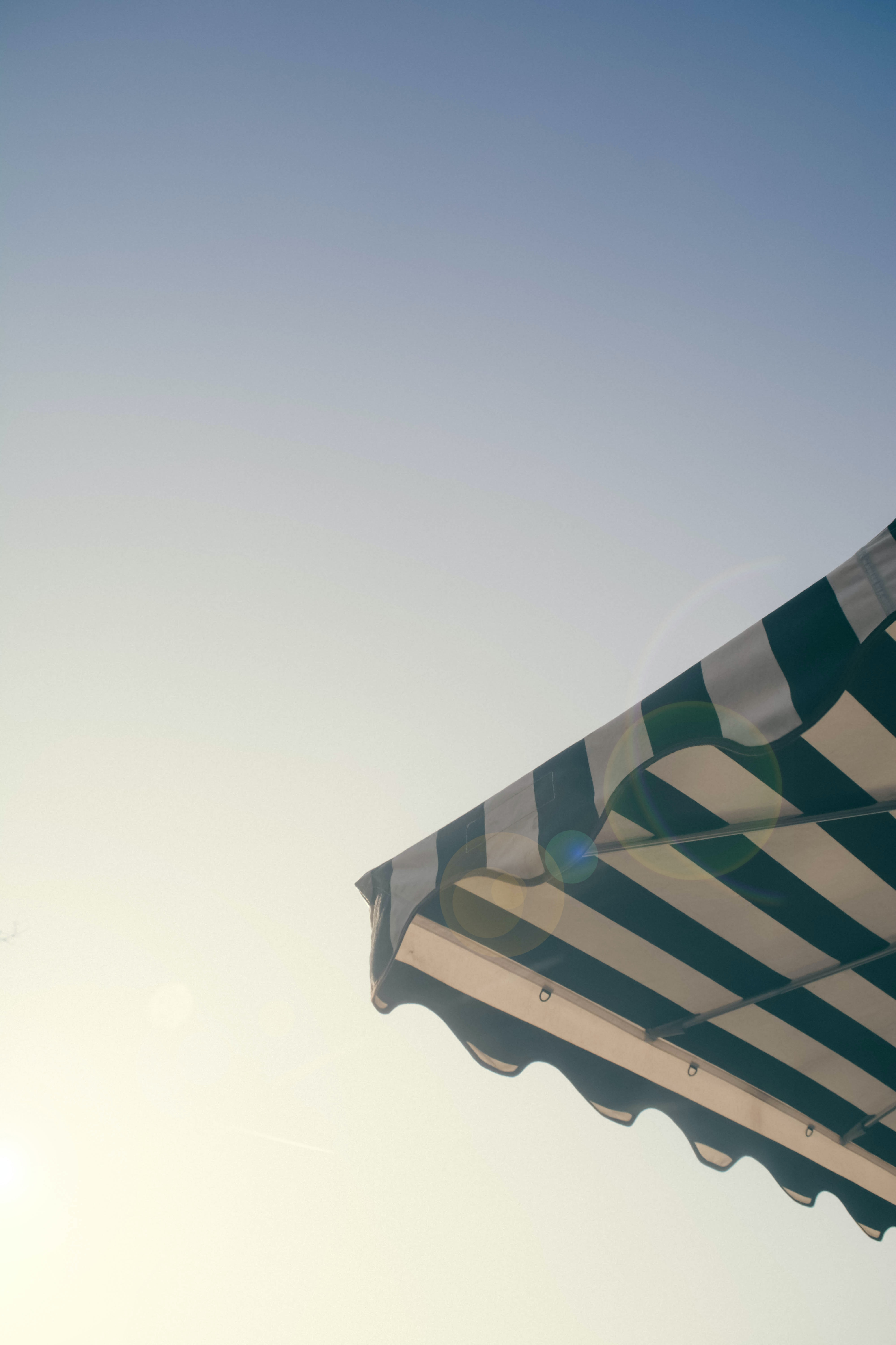 A green and white striped tent canopy.