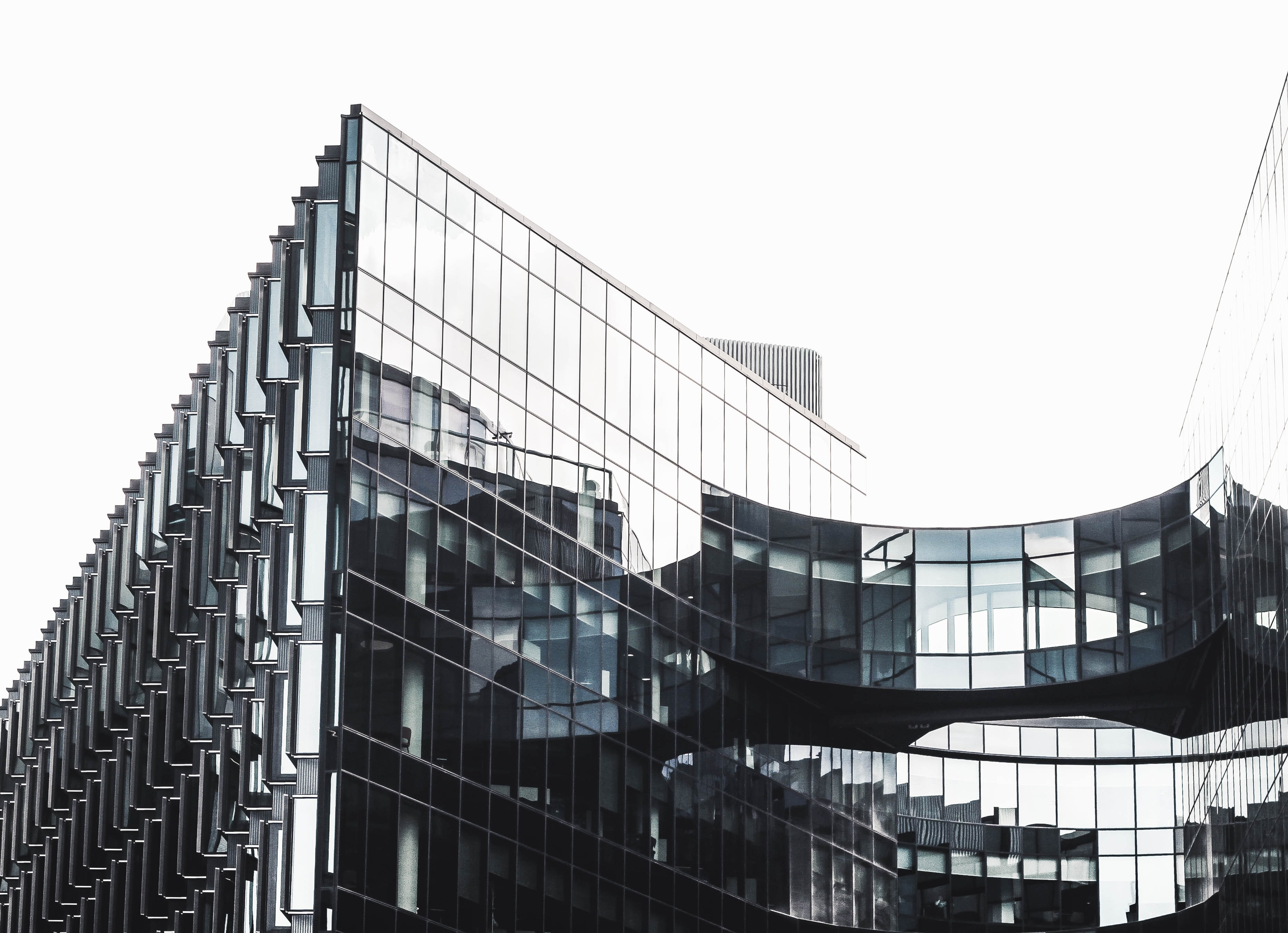 The glass facade of a modern office building in London