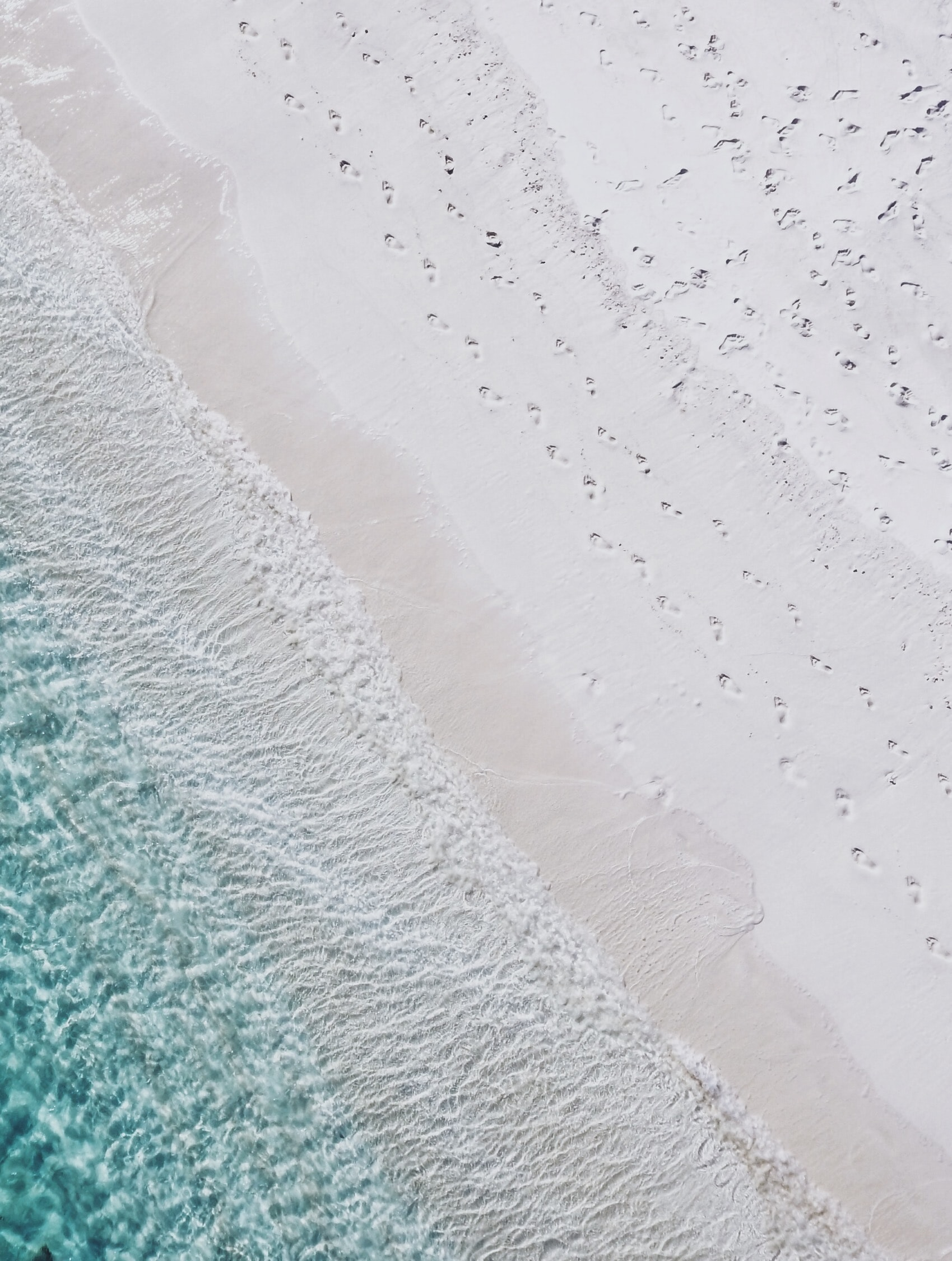 aerial photography of white sand seashore and green water beach