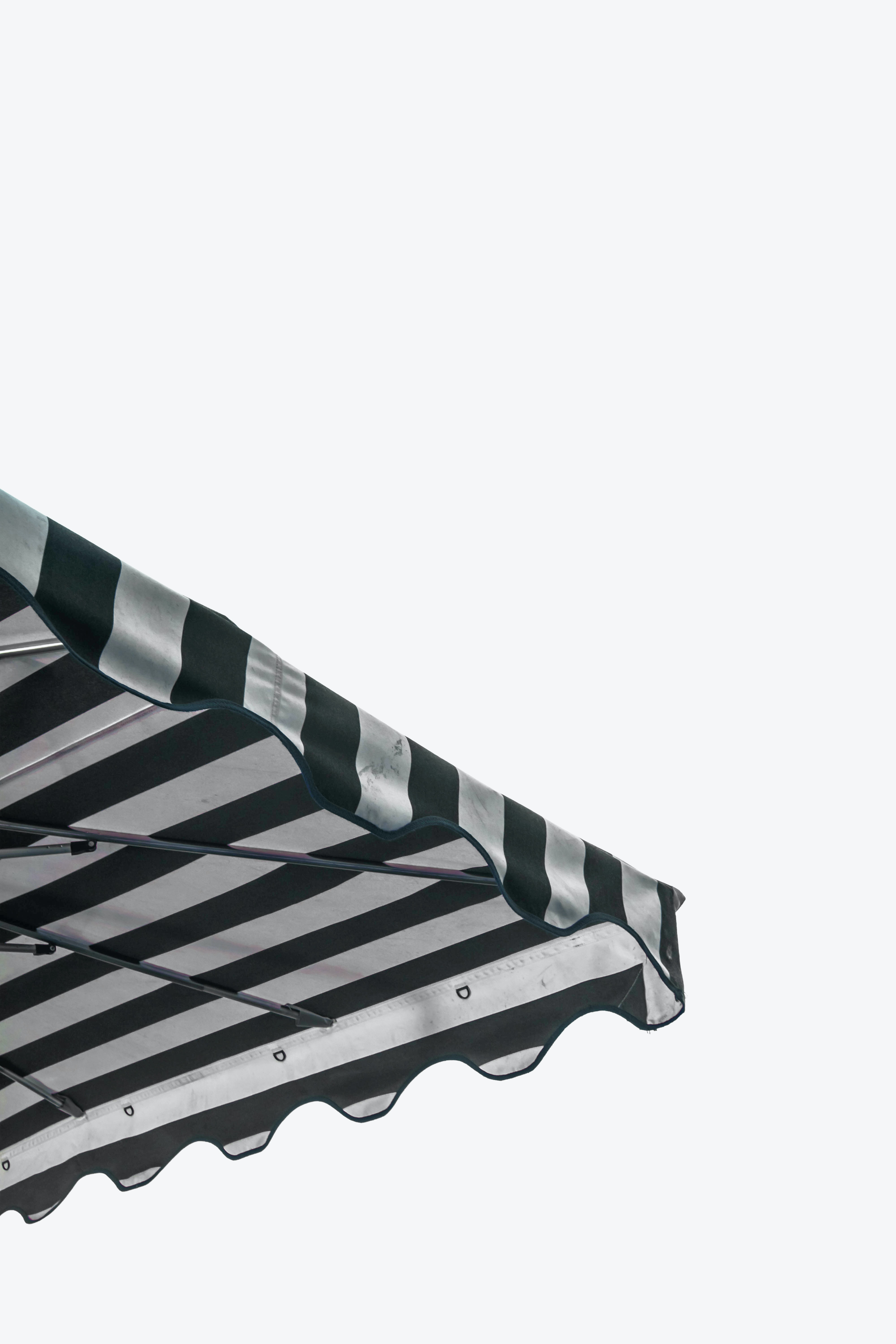 white and black striped canopy tent