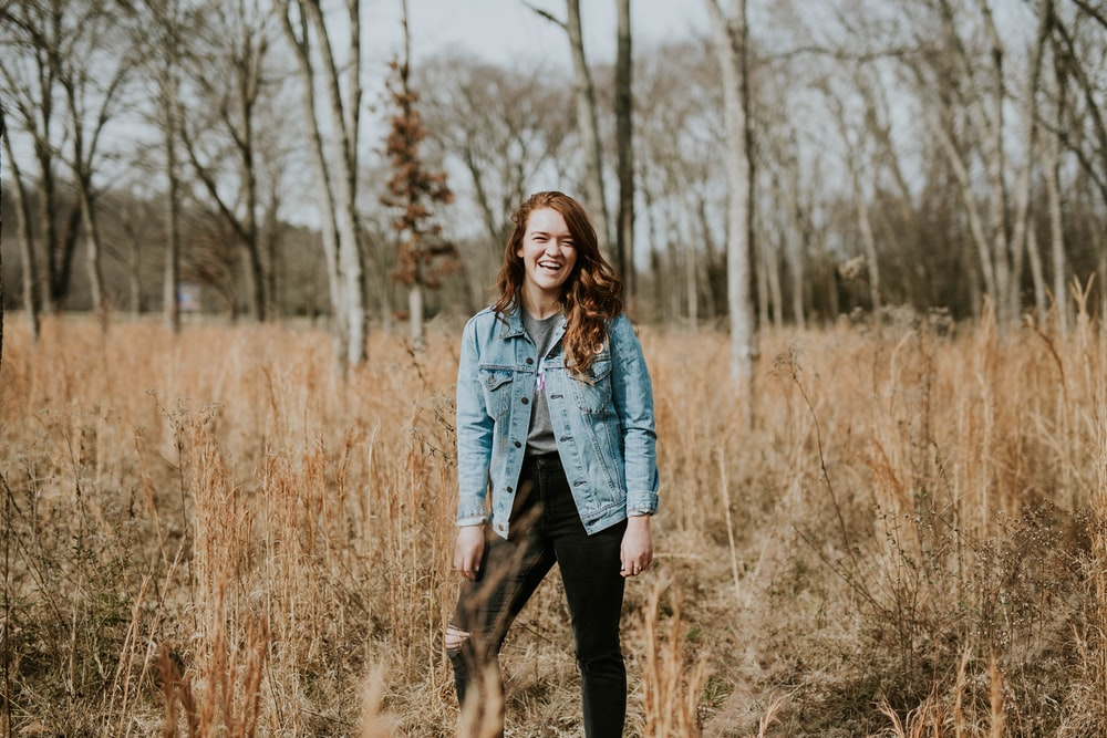 woman standing at forest while smiling