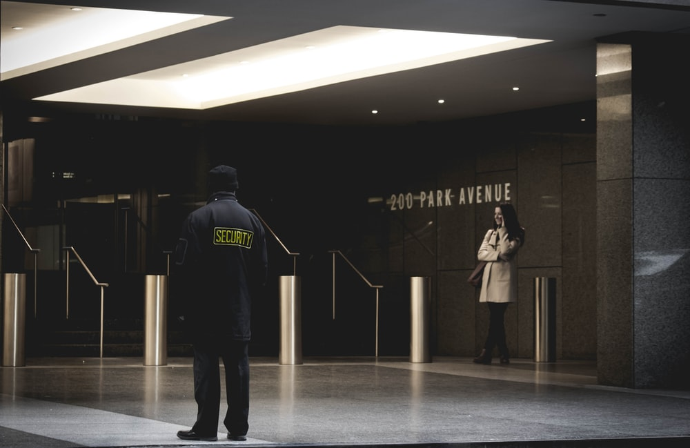 security guard standing on the gray floor