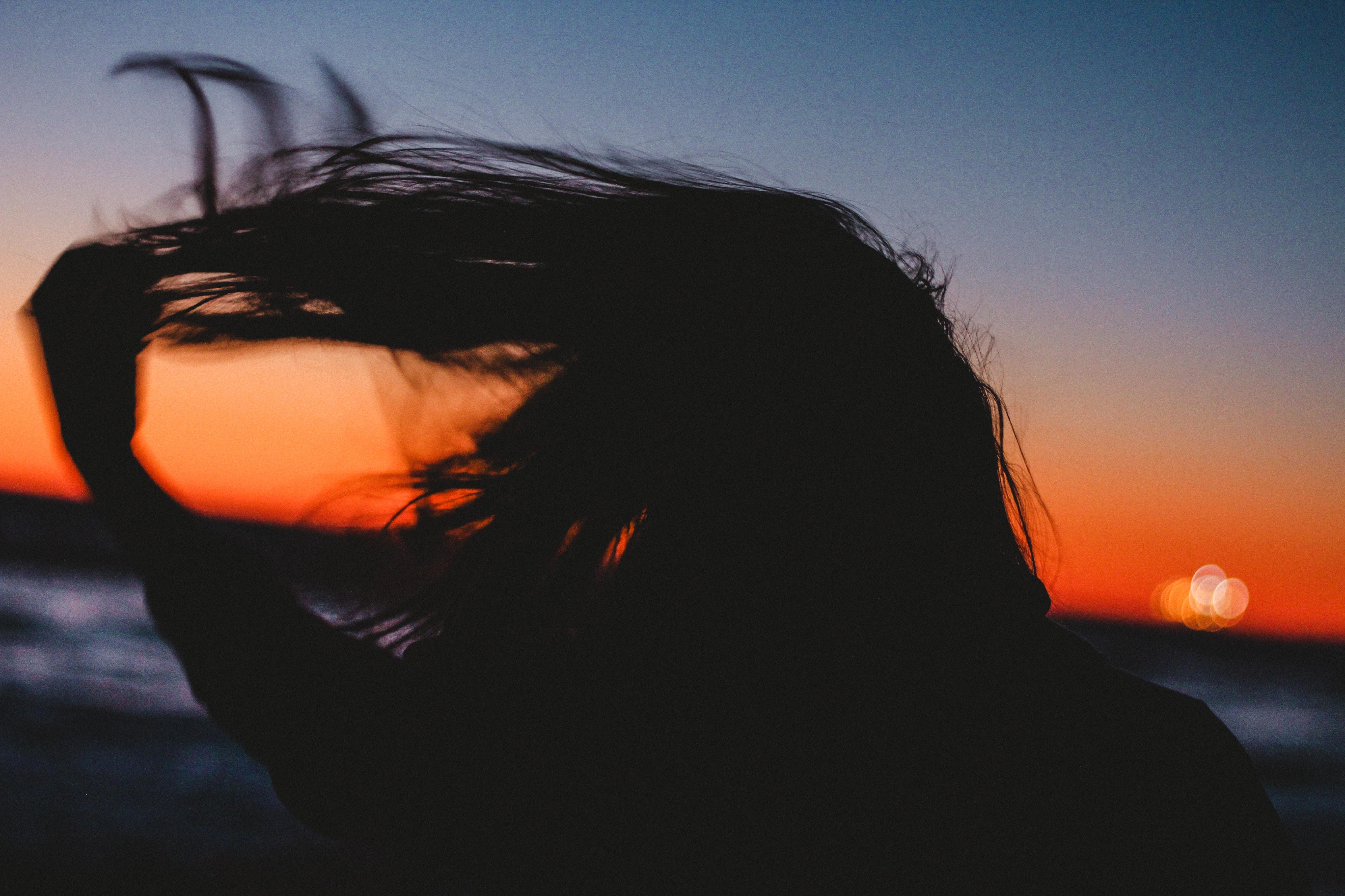 silhouet photo of woman hair