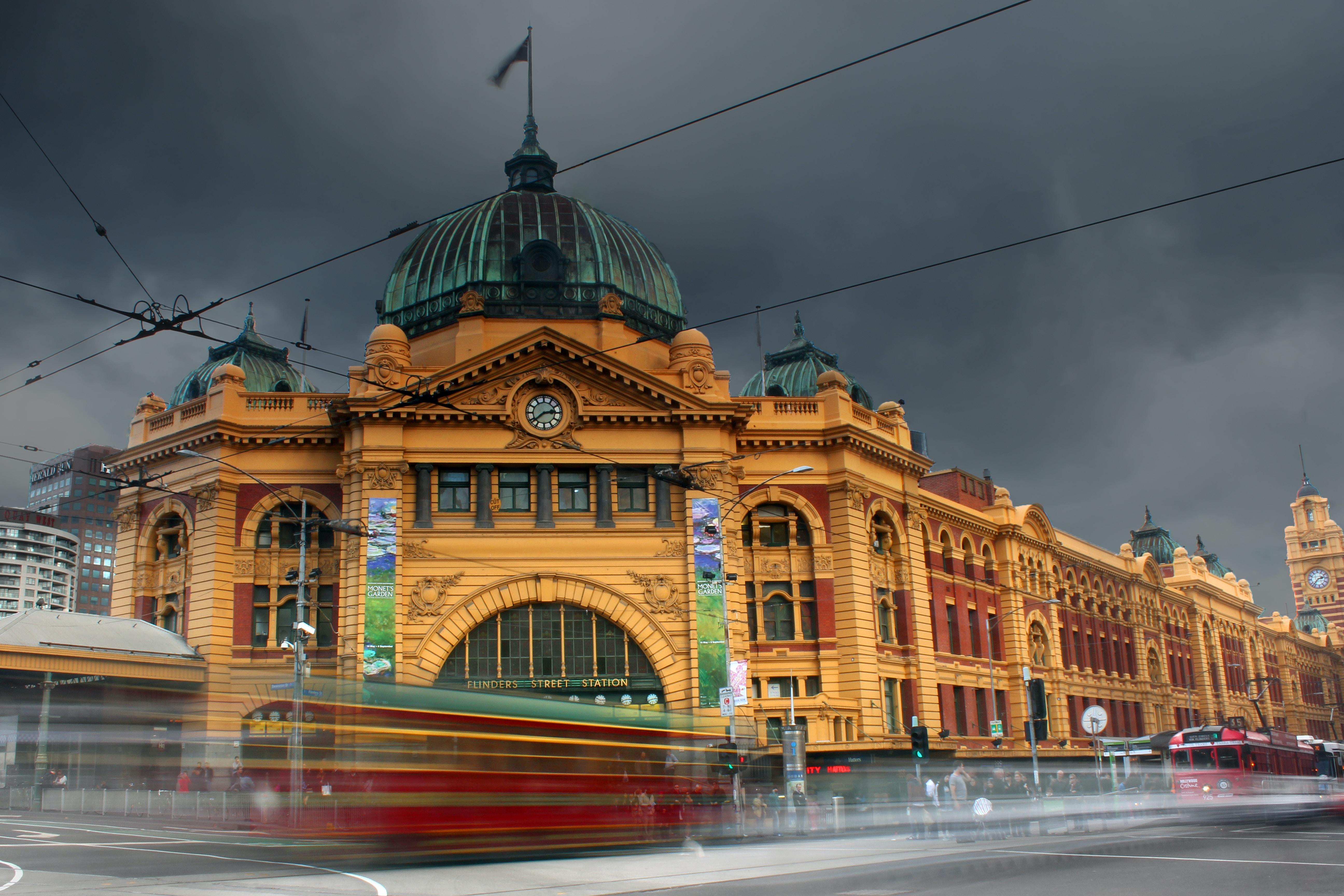 A blurred shot of traffic in motion on Flinders Street in Melbourne