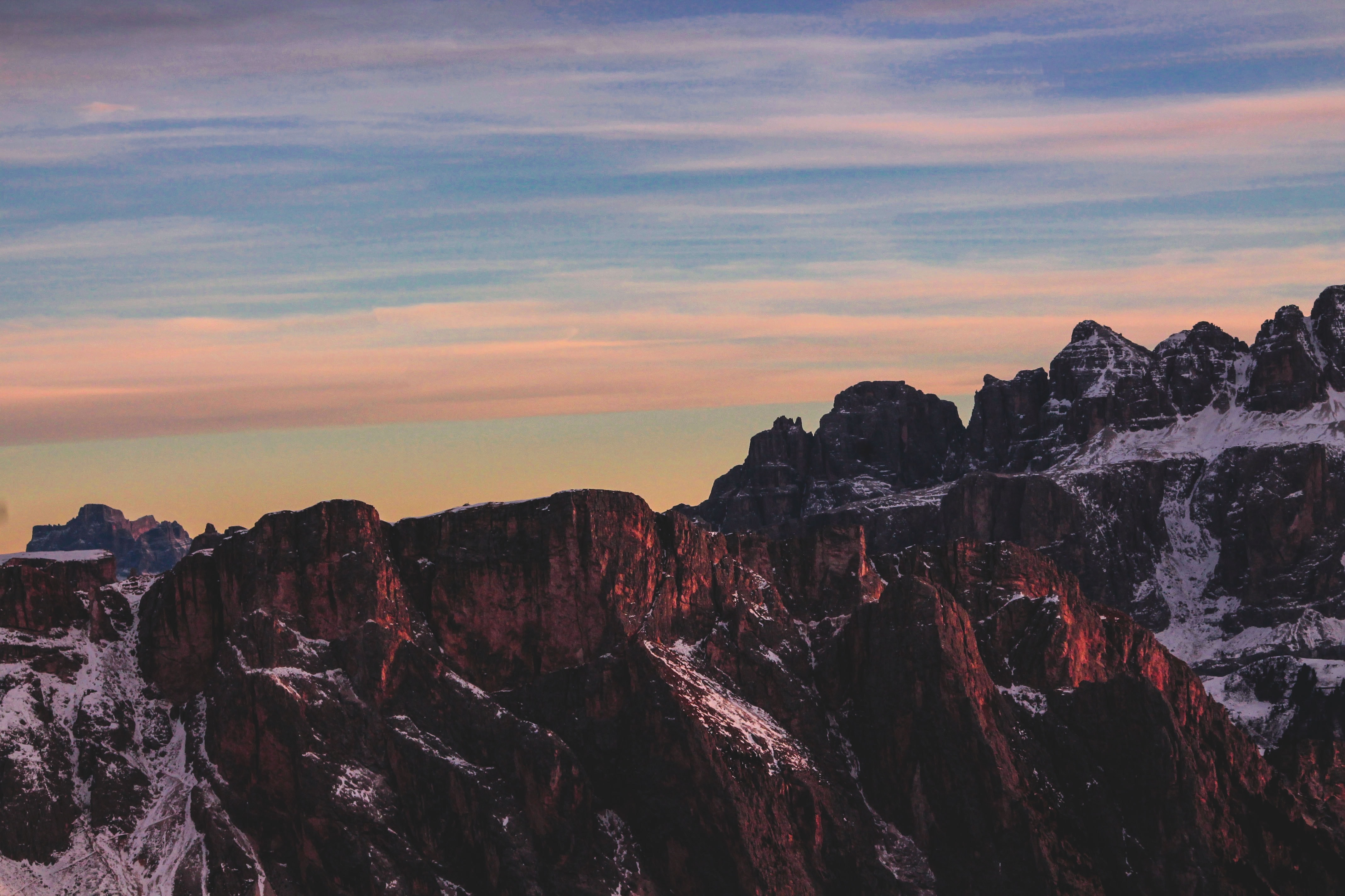 Sunset over the steep mountain crests in Seceda