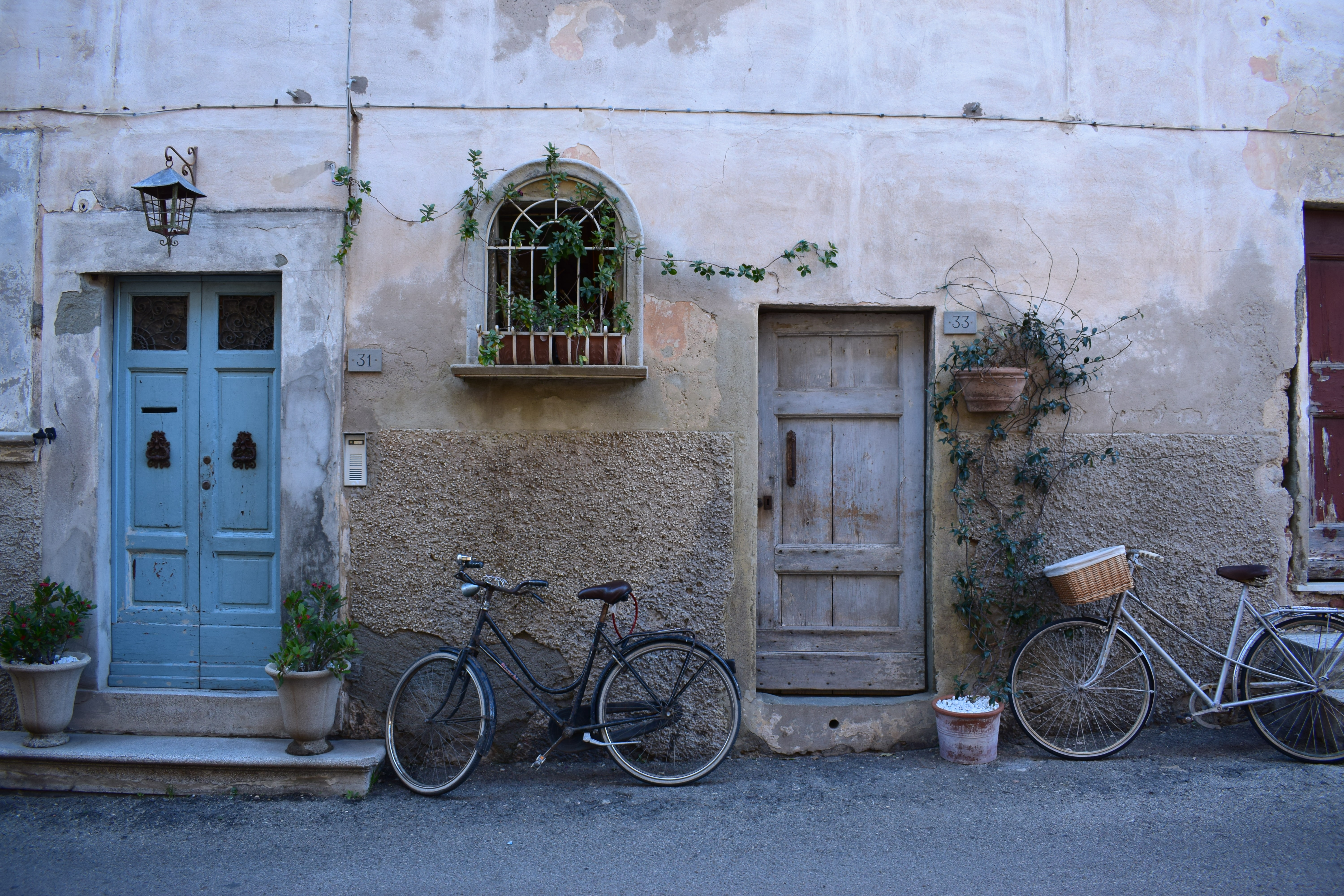Two bicycles parked near wooden doors in an old building facade & I have this thing with Bikes | 7 best free bike city bicycle and ...